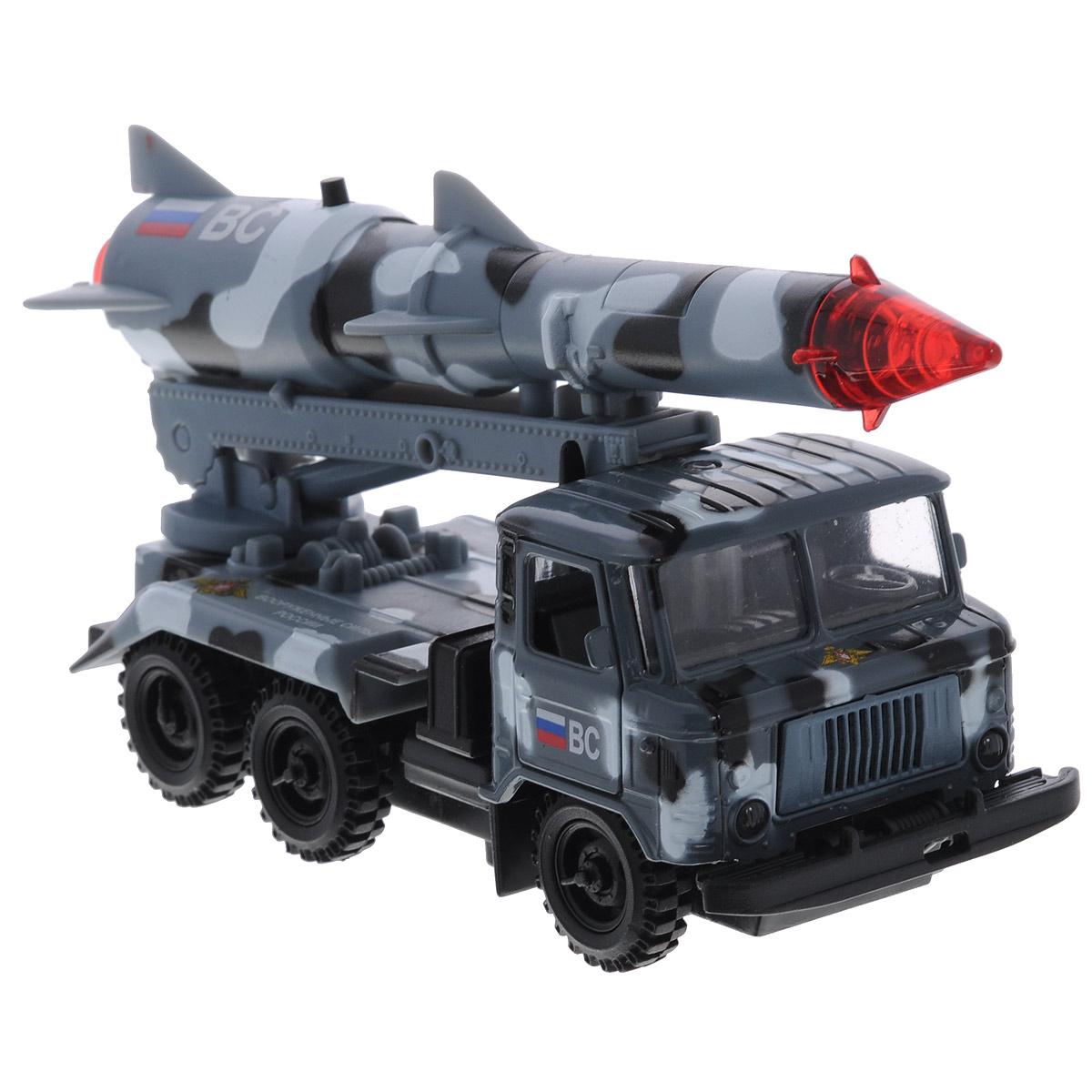 ТехноПарк Машинка инерционная ГАЗ 66 с ракетой цвет серый камуфляжCT-1299-R-4Инерционная машинка ТехноПарк Газ 66 с ракетой Космос, выполненная из пластика и металла, станет любимой игрушкой вашего малыша. Игрушка представляет собой модель военного автомобиля Газ 66, оснащенного подвижной пусковой установкой с ракетой. Дверцы и капот машинки открываются. При нажатии кнопки на ракете боеголовка начинает мигать, при этом слышны звуки стрельбы и команды военных. Игрушка оснащена инерционным ходом. Машинку необходимо отвести назад, затем отпустить - и она быстро поедет вперед. Прорезиненные колеса обеспечивают надежное сцепление с любой гладкой поверхностью. Ваш ребенок будет часами играть с этой машинкой, придумывая различные истории. Порадуйте его таким замечательным подарком! Машинка работает от батареек (товар комплектуется демонстрационными).