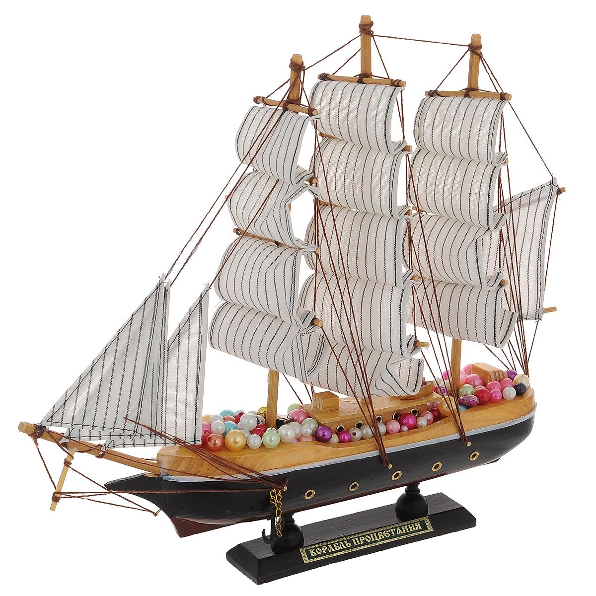Корабль сувенирный Корабль процветания, длина 33 см08010102Сувенирный корабль Корабль процветания, изготовленный из дерева, металла и текстиля, это великолепный элемент декора рабочей зоны в офисе или кабинете. Корабль с парусами и якорями помещен на деревянную подставку. Палуба корабля украшена разноцветными бусинами. Время идет, и мы становимся свидетелями развития технического прогресса, новых учений и практик. Но одно не подвластно времени - это любовь человека к морю и кораблям. Сувенирный корабль наполнен историей и силой океанских вод. Данная модель кораблика станет отличным подарком для всех любителей морей, поклонников историй о покорении океанов и неизведанных земель. Модель корабля - подарок со смыслом. Издавна на Руси считалось, что корабли приносят удачу и везение. Поэтому их изображения, фигурки и точные копии всегда присутствовали в помещениях. Удивите себя и своих близких необычным презентом. Размер корабля (с учетом подставки): 33 см х 6 см х 32 см.
