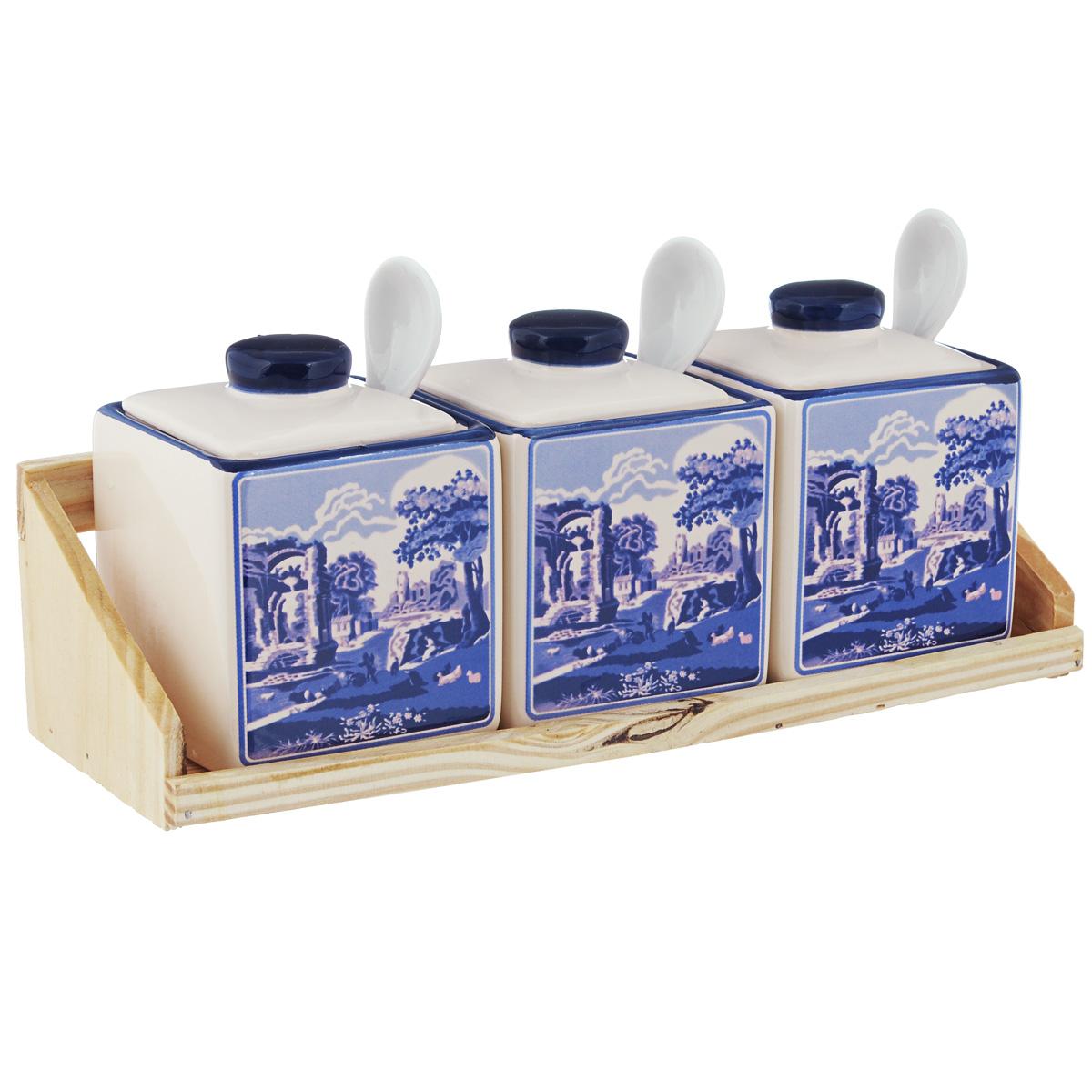 Набор банок для сыпучих продуктов Korall Старый замок, с ложками, на деревянной подставке, 7 предметов750912Набор Korall Старый замок состоит из трех банок для сыпучих продуктов. Изделия выполнены из высококачественной глазурованной керамики, оформленной ярким необычным рисунком в стиле Гжель. Керамика - это экологически чистый материал, который не наносит вред вашему здоровью. Кроме того, этот материал защищает продукты и пищу от образования вредных бактерий, которые могут испортить аромат и вкус пищи. Банки предназначены для хранения различных сыпучих продуктов: орехов, сахара, соли, специй и т.д. В комплекте - три керамические ложки, для которых предусмотрены специальные выемки на крышках. Изделия устанавливаются на деревянную подставку. Набор Korall Старый замок - это привлекательный внешний вид, прочность и универсальность. Набор гармонично вписывается в любой интерьер, дополняя его и делая максимально комфортным. Отличается особым очарованием, неповторимым стилем и манящим изяществом. Размер банки: 7,3 см х 7,3 см х 7,5 см. ...