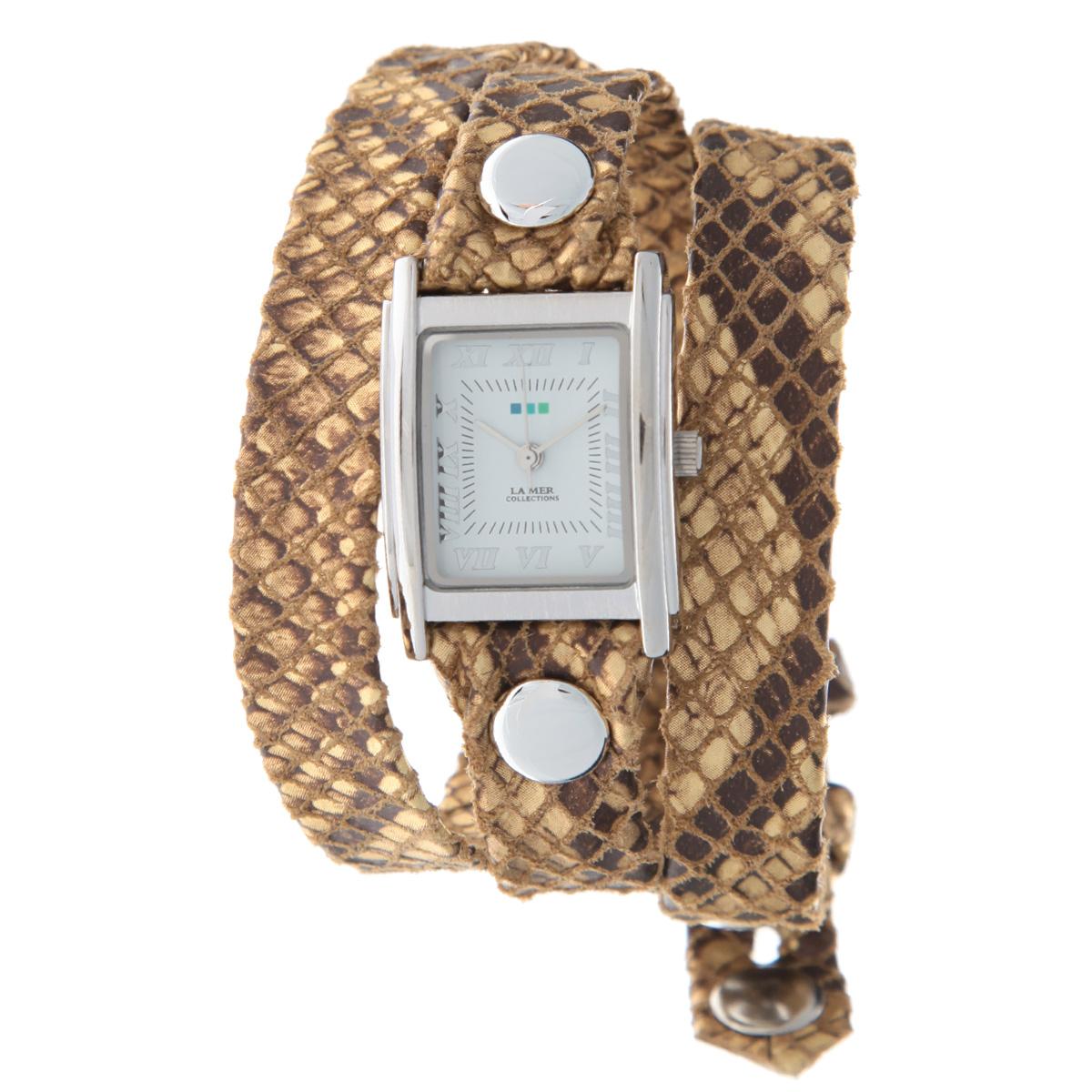 Часы наручные женские La Mer Collections Simple Cobra Snake. LMSTW6000xLMSTW6000xЖенские наручные часы  La Mer Collections позволят вам выделиться из толпы и подчеркнуть свою индивидуальность. Часы оснащены японским кварцевым механизмом Seiko. Ремешок выполнен из натуральной итальянской замши и декорирован металлическими заклепками и принтом под змеиную кожу. Корпус часов изготовлен из сплава металлов, серебристого цвета. Циферблат оснащен часовой, минутной и секундной стрелками и защищен минеральным стеклом. Часы застегиваются на классическую застежку. Часы хранятся на специальной подушечке в футляре из искусственной кожи, крышка которого оформлена логотипом компании La Mer Collection. Характеристики: Размер циферблата: 25 х 23 х 8 мм. Размер ремешка: 550 х 13 мм. Не содержат никель. Не водостойкие. Собираются вручную в США.