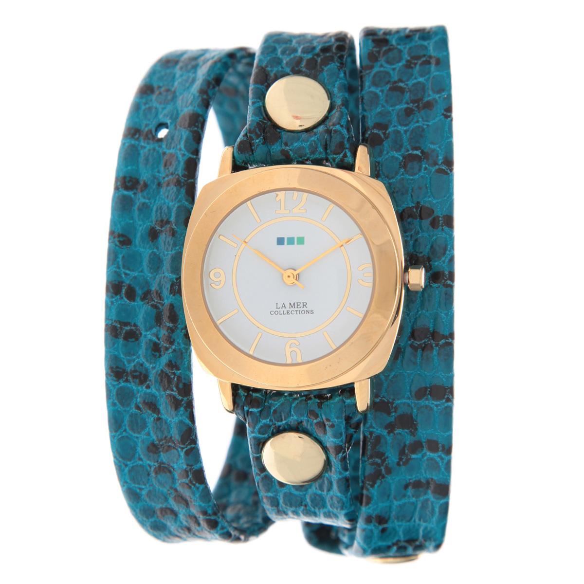 Часы наручные женские La Mer Collections Odyssey Aqua Blue Snake. LMODY4002xLMODY4002xЖенские наручные часы  La Mer Collections позволят вам выделиться из толпы и подчеркнуть свою индивидуальность. Часы оснащены японским кварцевым механизмом SEIKO. Ремешок выполнен из натуральной итальянской кожи и декорирован металлическими заклепками и принтом под змеиную кожу. Корпус часов изготовлен из сплава металлов, золотистого цвета. Циферблат оснащен часовой, минутной и секундной стрелками и защищен минеральным стеклом. Часы застегиваются на классическую застежку. Часы хранятся на специальной подушечке в футляре из искусственной кожи, крышка которого оформлена логотипом компании La Mer Collection. Характеристики: Размер циферблата: 29 х 29 х 8 мм. Размер ремешка: 550 х 13 мм. Не содержат никель. Не водостойкие. Собираются вручную в США.