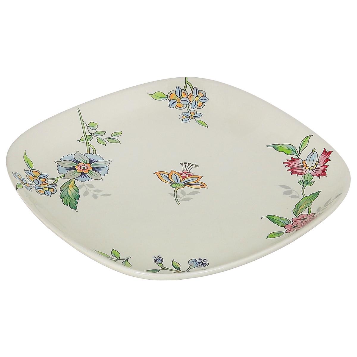 Тарелка Nuova Cer Прованс, 19 см х 19 смPRV-1590/4Изящная тарелка Nuova Cer Прованс изготовлена из высококачественной керамики. Изделие оформлено красочным изображением цветов. Предназначена для сервировки закусок и различных блюд. Оригинальная тарелка прекрасно оформит стол и порадует вас лаконичным и ярким дизайном. Можно использовать в микроволновой печи и мыть в посудомоечной машине. Размер тарелки (по верхнему краю): 19 см х 19 см. Высота тарелки: 2,2 см.