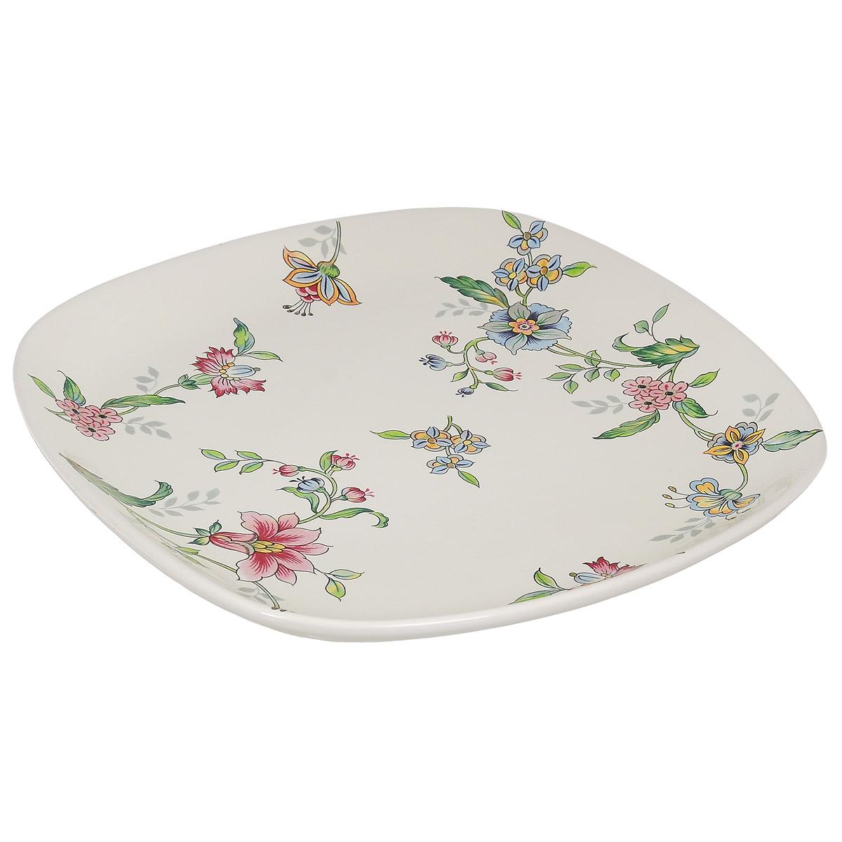 Тарелка Nuova Cer Прованс, 25,5 см х 25,5 смPRV-1590/2Изящная тарелка Nuova Cer Прованс изготовлена из высококачественной керамики. Изделие оформлено красочным изображением цветов. Предназначена для сервировки закусок и различных блюд, а также для подачи вторых блюд. Оригинальная тарелка прекрасно оформит стол и порадует вас лаконичным и ярким дизайном. Можно использовать в микроволновой печи и мыть в посудомоечной машине. Размер тарелки (по верхнему краю): 25,5 см х 25,5 см. Высота тарелки: 3,3 см.
