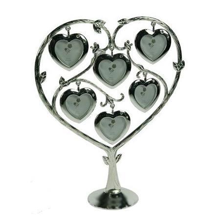 Декоративная фоторамка Сердце, на 6 фото. 264007264007Декоративная фоторамка Сердце выполнена из металла серебристого цвета. На подставку в виде дерева подвешены 6 рамочек в форме сердца, украшенных стразами. Изысканная и эффектная, эта потрясающая рамочка покорит своей красотой и изумительным качеством исполнения. Декоративная фоторамка Сердце не только украсит интерьер помещения, но и внесет нотки изысканности и оригинальности.