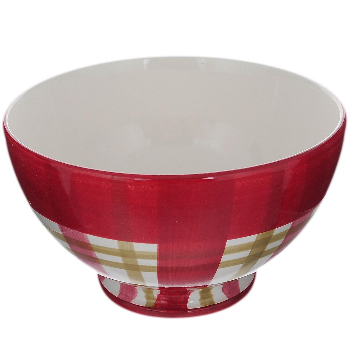 Салатник Polnaya Chasha Вишня, диаметр 18 смВ63627АСалатник Polnaya Chasha Вишня изготовлен из высококачественной глазурованной керамики и оформлен рисунком в клетку. Такой салатник прекрасно подойдет для подачи салатов и закусок. Он ярко украсит ваш стол и станет практичным аксессуаром на вашей кухне. Коллекция Вишня - это очень модный и современный дизайн для использования каждый день на вашем столе. Каждый предмет данной коллекции эксклюзивно раскрашен вручную с помощью ярких устойчивых красок. Подходит для использования в микроволновых печах, а также для мытья в посудомоечных машинах. Диаметр: 18 см. Высота стенки: 10,5 см.