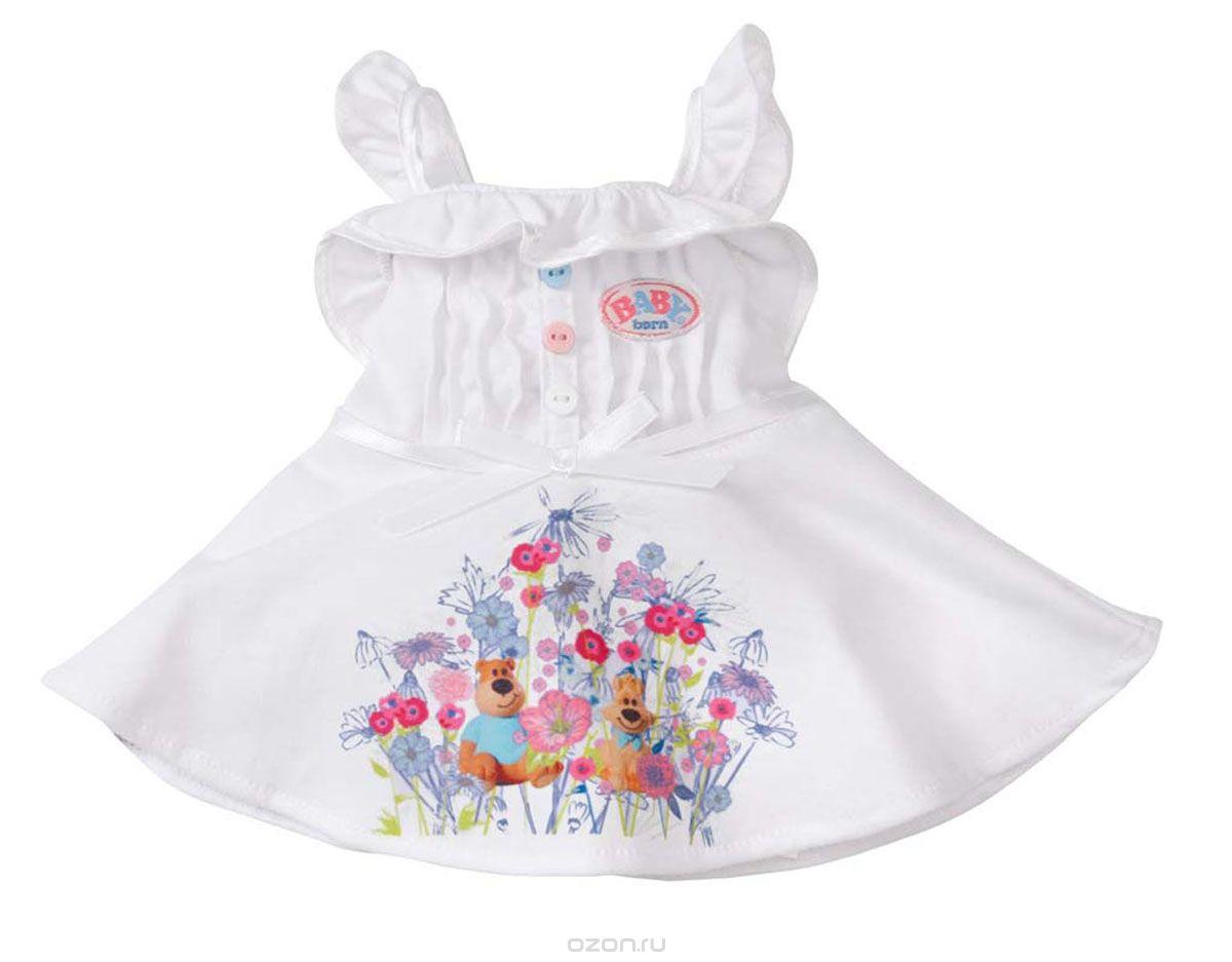 Baby Born Платье для куклы цвет белый819-418_белыйПлатье Baby Born предназначено для куклы Baby Born высотой 43 см. Платье выполнено из текстильного материала белого цвета и украшено пуговичками и термоаппликацией в виде цветочков и двух зверьков. Сзади застегивается на липучки. Платье поставляется вместе с оригинальной вешалкой, поэтому у маленькой мамы не будет забот, как его хранить.