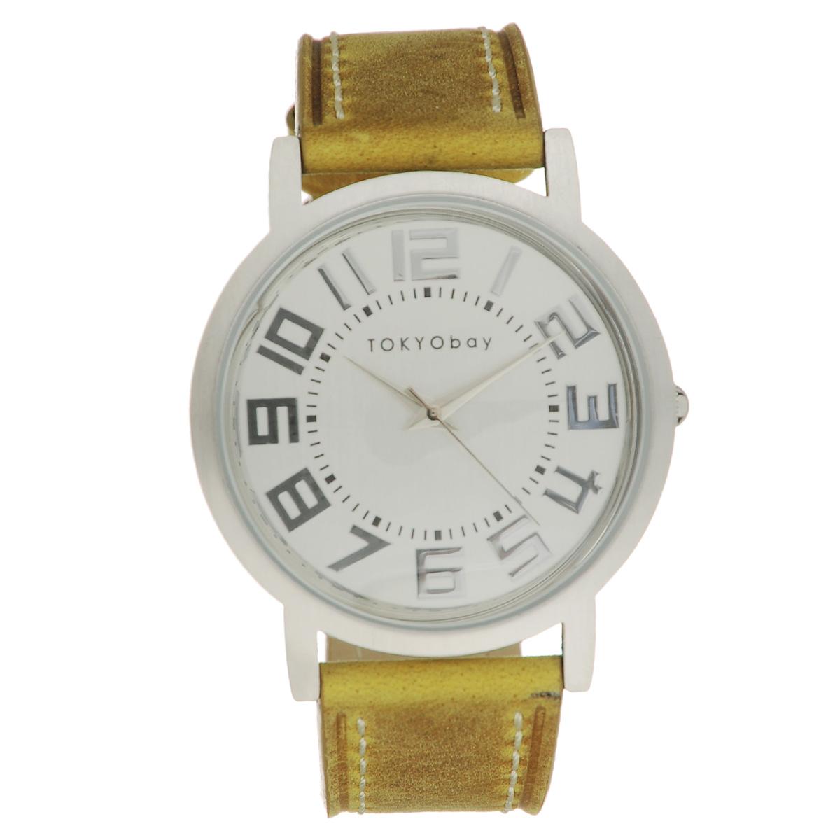 Часы женские наручные Tokyobay Platform, цвет: горчичный. T135-TANT135-TANНаручные часы Tokyobay - это стильное дополнение к вашему неповторимому образу. Эти часы созданы для современных женщин, ценящих стиль, качество и практичность. Часы оснащены японским кварцевым механизмом Miyota. Задняя крышка изготовлена из нержавеющей стали. Корпус изготовлен из металла. Циферблат оформлен крупными металлическими цифрами, имеются часовая, минутная и секундная стрелки. Ремешок выполнен из кожи, декорирован контрастной отстрочкой и застегивается на классическую застежку- пряжку. Часы Tokyobay - это практичный и модный аксессуар, который подчеркнет ваш безупречный вкус. Характеристики: Корпус: 3,8 х 3,8 х 0,8 см. Размер ремешка: 21 х 2,2 см. Не содержит никель. Не водостойкие.