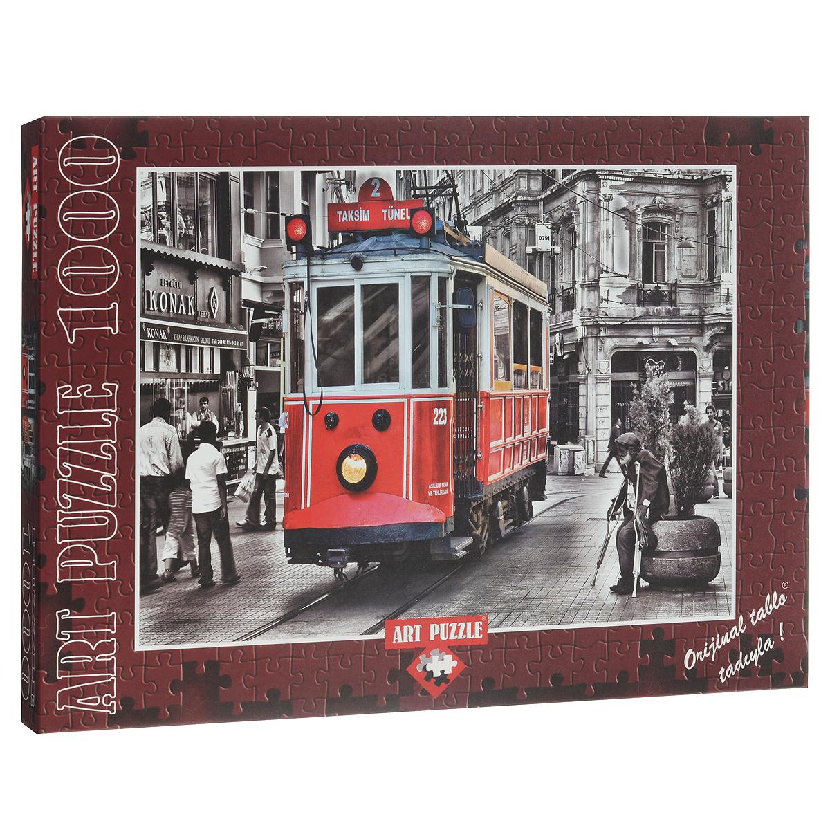 Трамвай, Стамбул. Пазл, 1000 элементов4336Пазл Art Puzzle Трамвай, Стамбул понравится всем членам вашей семьи. Собрав этот пазл, включающий в себя 1000 элементов, вы получите замечательную картину с изображением турецкого трамвая. Пазл изготовлен из картона высочайшего качества. Каждая деталь имеет свою форму и подходит только на свое место. Изображение аккуратно отсканировано и напечатано на ламинированной бумаге. Пазл - великолепная игра для семейного досуга. Сегодня собирание пазлов стало особенно популярным, главным образом, благодаря своей многообразной тематике, способной удовлетворить самый взыскательный вкус. А для детей это не только интересно, но и полезно. Собирание пазла развивает мелкую моторику у ребенка, тренирует наблюдательность, логическое мышление, знакомит с окружающим миром, с цветом и разнообразными формами.
