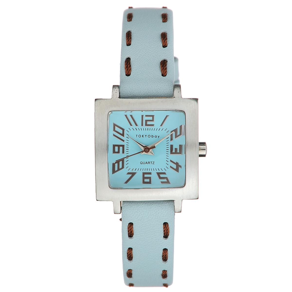 Часы женские наручные Tokyobay Tramette, цвет: голубой, коричневый. T206-LTBLT206-LTBLНаручные часы Tokyobay - это стильное дополнение к вашему неповторимому образу. Эти часы созданы для современных девушек, ценящих стиль, качество и практичность. Часы оснащены японским кварцевым механизмом Miyota. Корпус выполнен из сплава металлов, не содержащего никель. Задняя крышка изготовлена из нержавеющей стали. Циферблат оформлен крупными арабскими цифрами, имеет три стрелки - часовую, минутную и секундную. Циферблат защищен ударопрочным оптическим пластиком. Ремешок выполнен из натуральной кожи и текстиля, застегивается на классическую застежку-пряжку. Часы Tokyobay - это практичный и модный аксессуар, который подчеркнет ваш безупречный вкус. Характеристики: Корпус: 2,2 х 2,2 х 0,8 см. Размер ремешка: 18 х 1,2 см. Не содержит никель. Не водостойкие.