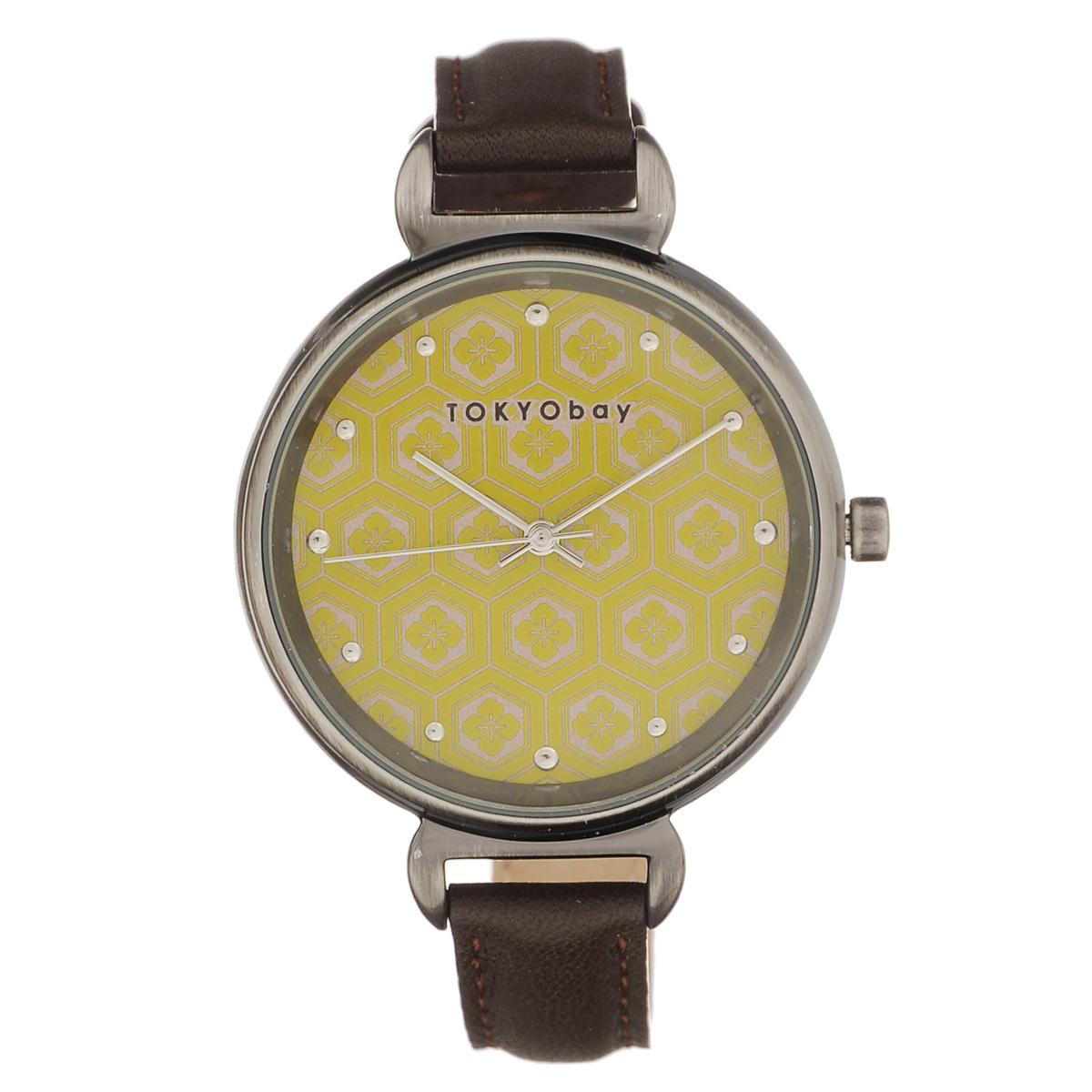 Часы женские наручные Tokyobay Mitsu, цвет: коричневый, горчичный. T399-MUT399-MUНаручные часы Tokyobay - это стильное дополнение к вашему неповторимому образу. Эти часы созданы для современных девушек, ценящих стиль, качество и практичность. Часы оснащены японским кварцевым механизмом Miyota. Корпус круглой формы выполнен из сплава металлов, не содержащего никель. Задняя крышка изготовлена из нержавеющей стали. Циферблат оформлен металлическими отметками и узором из цветков, имеет три стрелки - часовую, минутную и секундную. Циферблат защищен ударопрочным оптическим пластиком. Ремешок выполнен из натуральной кожи и застегивается на классическую застежку. Часы Tokyobay - это практичный и модный аксессуар, который подчеркнет ваш безупречный вкус. Характеристики: Корпус: 3,6 х 3,2 х 0,8 см. Размер ремешка: 19 х 1,2 см. Не содержит никель. Не водостойкие.