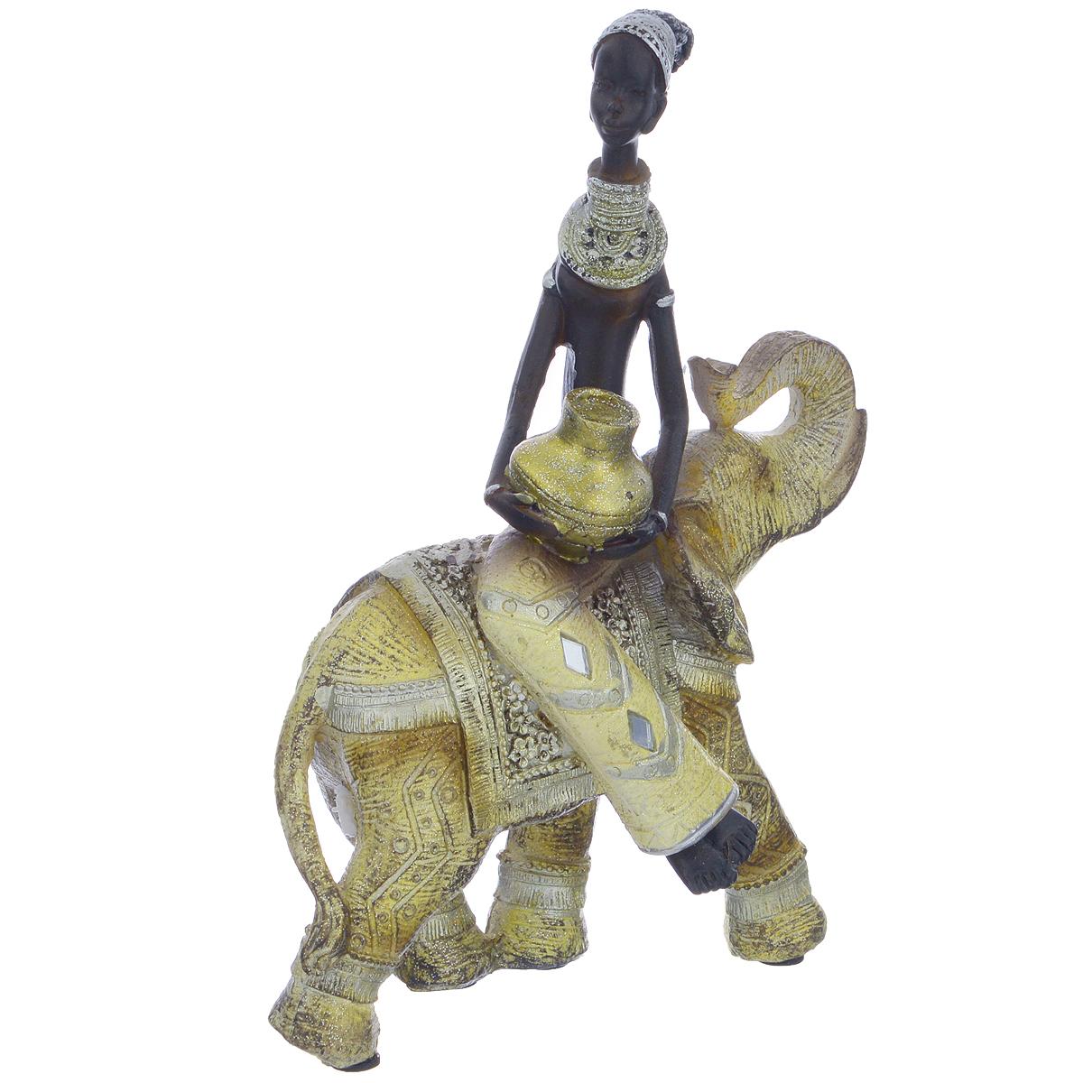 Фигурка декоративная Molento Африканка и слон, высота 20,5 см549-200Декоративная фигура Molento Африканка и слон, изготовленная из полистоуна, позволит вам украсить интерьер дома, рабочего кабинета или любого другого помещения оригинальным образом. Изделие, выполненное в виде африканской женщины на слоне, оформлено рельефным рисунком и блестками. С такой декоративной фигурой вы сможете не просто внести в интерьер элемент оригинальности, но и создать атмосферу загадочности и изысканности. Размер фигурки: 15,5 см х 7 см х 20,5 см.
