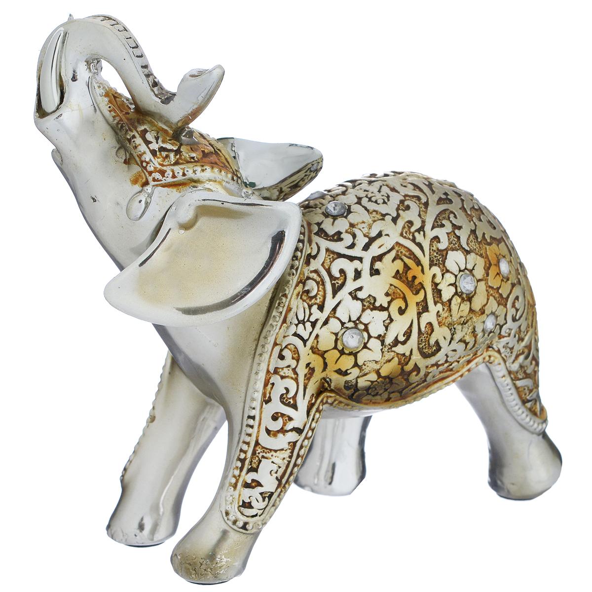 Фигурка декоративная Molento Нарядный слон, высота 11 см549-098Декоративная фигурка Molento Нарядный слон, изготовленная из полистоуна, выполнена в виде слона и украшена рельефным рисунком и стразами. Такая фигурка станет отличным дополнением к интерьеру. Вы можете поставить фигурку в любом месте, где она будет удачно смотреться, и радовать глаз. Кроме того, фигурка Нарядный слон станет чудесным сувениром для ваших друзей и близких. Размер фигурки: 11,5 см х 5 см х 11 см.