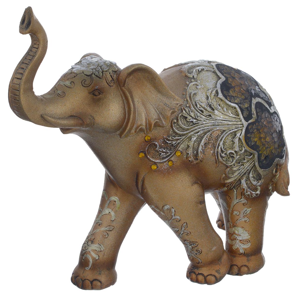 Фигурка декоративная Molento Слон с мозаикой, высота 21 см549-188Декоративная фигурка Molento Слон с мозаикой, выполненная из полистоуна, станет отличным украшением интерьера и подчеркнет его изысканность. Изделие, выполненное в виде слона, украшено рельефными узорами и мозаикой из стекла. Такая фигурка всегда сможет послужить приятным подарком для ваших друзей и близких. Размер фигурки: 24,5 см х 10 см х 21 см.
