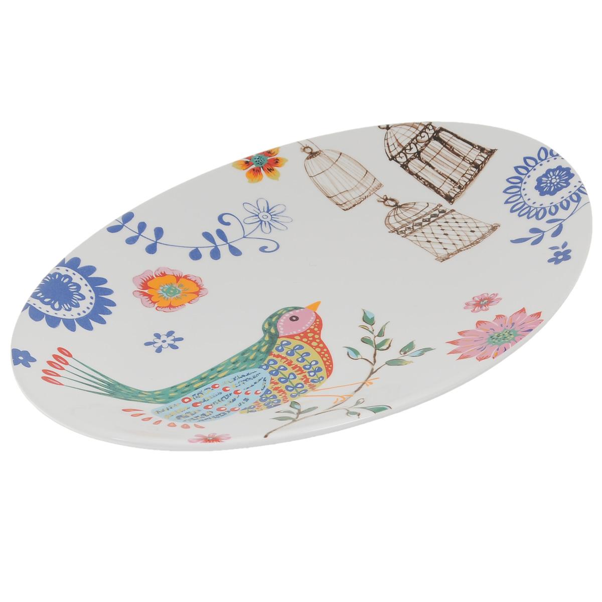 Блюдо Korall Синяя птица, 33 х 23 см799016Блюдо Korall Синяя птица, выполненное из керамики и декорированное красочным изображением птицы и цветов, сочетает в себе изысканный дизайн с максимальной функциональностью. Красочность оформления придется по вкусу и ценителям классики, и тем, кто предпочитает утонченность и изящность. Блюдо украсит сервировку вашего стола и подчеркнет прекрасный вкус хозяина, а также станет отличным подарком. Можно мыть в посудомоечной машине и использовать в микроволновой печи. Размер блюда (по верхнему краю): 33 см х 23 см. Высота блюда: 3 см.