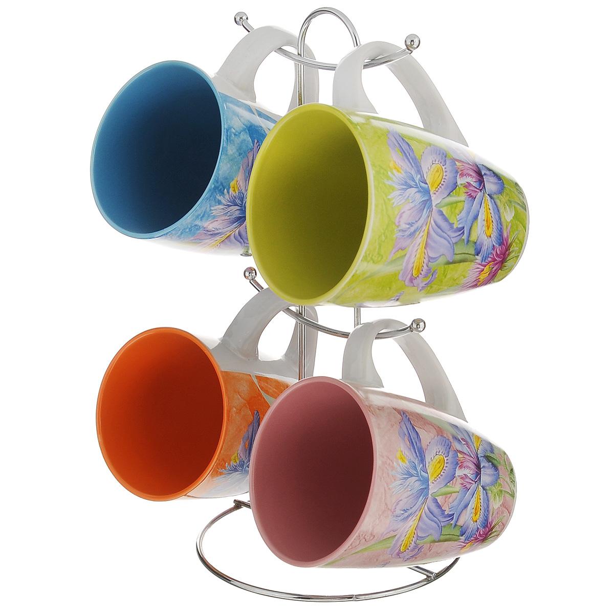 Набор кружек Korall Ирисы, на подставке, 5 предметов822726Набор Korall Ирисы состоит из 4 кружек, изготовленных из высококачественной керамики. Изделия оформлены ярким и красочным изображением ирисов. Все кружки разноцветные. Для кружек предусмотрена специальная металлическая подставка с крючками. Яркий дизайн кружек украсит сервировку стола к чаепитию и поднимет настроение. Идеальный вариант подарка, который понравится каждому. Объем кружки: 320 мл. Диаметр кружки (по верхнему краю): 8 см. Высота кружки: 10 см. Размер подставки: 13 см х 13 см х 26 см.