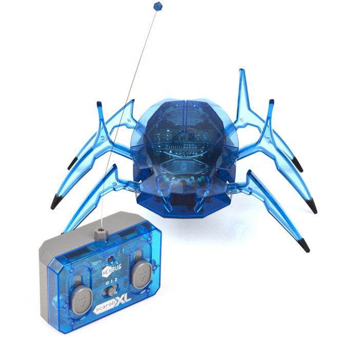 Микро-робот Hexbug Scarab XL, цвет: синий477-2423Микро-робот Hexbug Scarab XL - высокоскоростной механический робот-жук, внешне похожий на крупного скарабея. Он стал в 1,5 раза крупнее своего предшественника! В то же время, размеры и тяжесть гиганта компенсируются легкостью управления. Жук не имеет датчиков препятствий, поэтому он полностью полагается на собственные размеры и силу. Если он упадет на спину, то сможет перевернуться обратно на лапки! Микро-робот Hexbug Scarab XL станет отличным подарком для вашего ребенка. Робот-жук работает от 3 батареек типа AAA (не входят в комплект). Пульт радиоуправления работает от 1 батарейки Крона 9V (не входит в комплект). Гарантия: 15 дней.