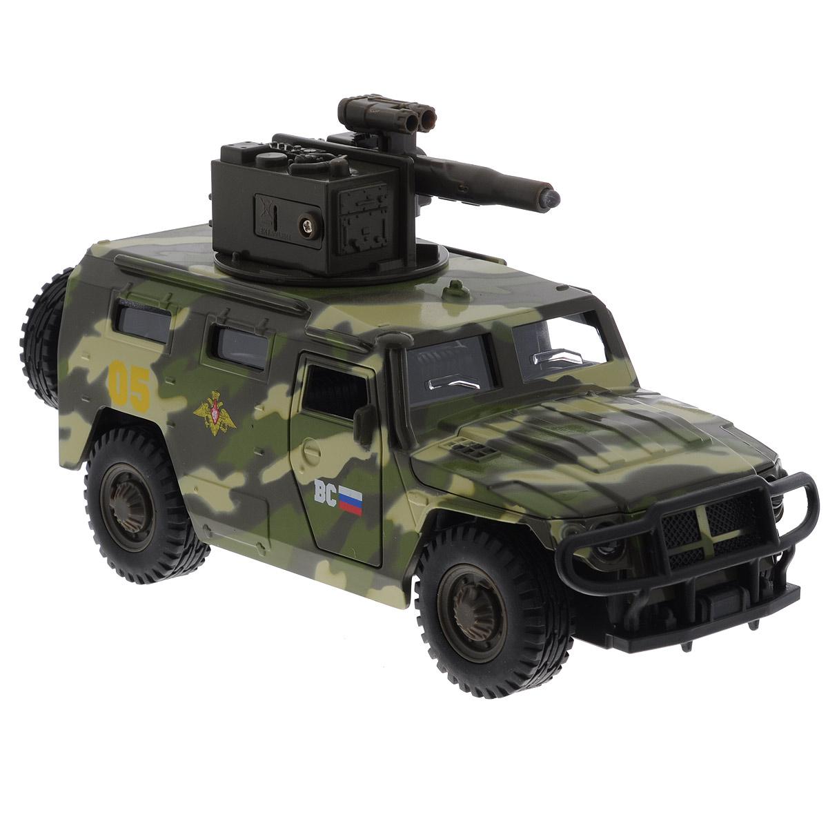 ТехноПарк Модель автомобиля ГАЗ ТигрCT12-392-G2Машинка ТехноПарк ГАЗ Тигр, выполненная из металла и пластика, станет любимой игрушкой вашего малыша. Игрушка представляет собой военный внедорожник ГАЗ Тигр, оснащенный открывающимися дверьми, капотом и багажником, а также вращающейся башней с пушкой. При нажатии кнопки на пушке кончик дула начинает светиться, при этом слышны звуки стрельбы и команды Огонь! В атаку!. Прорезиненные колеса обеспечивают надежное сцепление с любой поверхностью пола. Ваш ребенок будет часами играть с этой машинкой, придумывая различные истории. Порадуйте его таким замечательным подарком! Машинка работает от батареек (товар комплектуется демонстрационными).