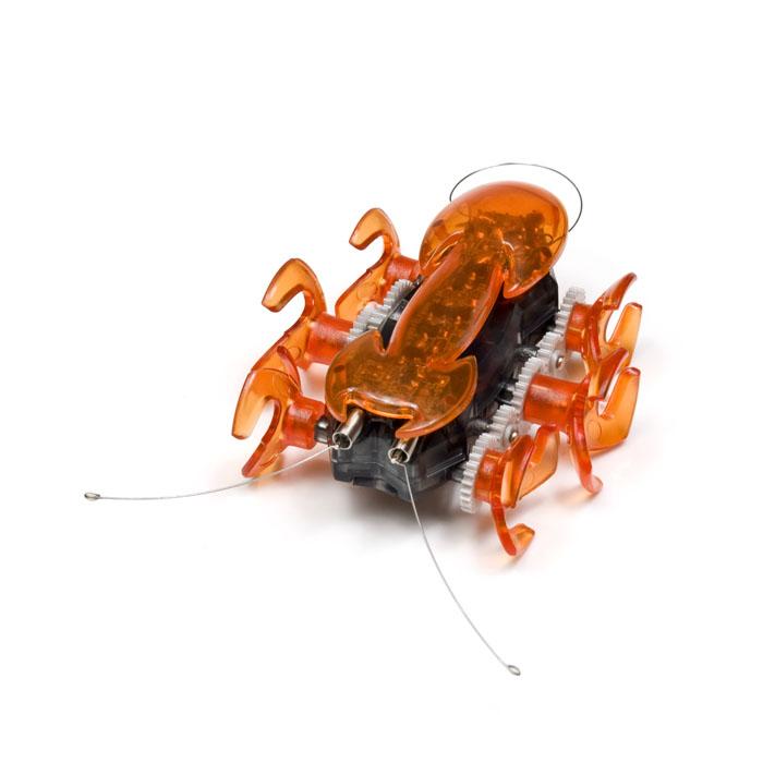 Микро-робот Hexbug Ant, цвет: оранжевый401-1363Микро-робот Hexbug Ant - самый быстрый представитель роботов-жуков. Он бегают на своих 6 лапках, издавая забавный механический звук. В случае столкновения с препятствием, робот- муравей сразу же поменяет направление движения. Это происходит благодаря сенсорам, расположенным с обеих сторон микро-робота. Так как корпус микро-робота прозрачный, можно легко рассмотреть, что же происходит внутри игрушечного муравья во время его молниеносных движений. Но все-таки гораздо интереснее наблюдать, как он бегает! Для этого лучше всего выбрать твердую гладкую поверхность, чтобы быть уверенным, что лапки робота-муравья нигде не застрянут. Микро-робот Hexbug Ant - отличное приобретение для вас и вашего ребенка. Hexbug Ant работает от 2 батареек типа AG13 (входят в комплект). Гарантия: 15 дней.