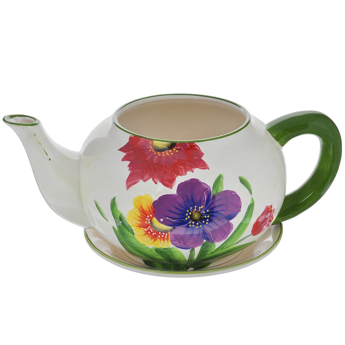 Кашпо Lillo Яркие цветы, с поддономXY10S012AКашпо-горшок для цветов Lillo Яркие цветы выполнен из прочной керамики в виде заварочного чайника с блюдцем. Изделие предназначено для цветов. Такие изделия часто становятся последним штрихом, который совершенно изменяет интерьер помещения или ландшафтный дизайн сада. Благодаря такому кашпо вы сможете украсить вашу комнату, офис, сад и другие места. Изделие оснащено специальным поддоном - блюдцем. Диаметр кашпо по верхнему краю: 14,5 см. Высота кашпо (без учета поддона): 16 см. Диаметр поддона: 23 см.