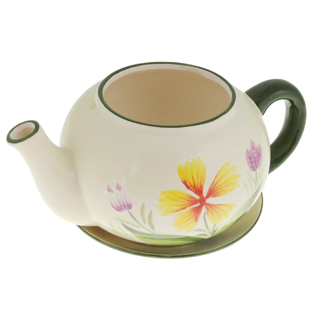 Кашпо Lillo Заварочный чайник, с поддоном. XY10S015-1BXY10S015-1BКашпо-горшок для цветов Lillo Заварочный чайник выполнен из прочной керамики и декорирован красочным рисунком. Изделие предназначено для цветов. Такие изделия часто становятся последним штрихом, который совершенно изменяет интерьер помещения или ландшафтный дизайн сада. Благодаря такому кашпо вы сможете украсить вашу комнату, офис, сад и другие места. Изделие оснащено специальным поддоном - блюдцем. Диаметр кашпо по верхнему краю: 12 см. Высота кашпо (без учета поддона): 14 см. Диаметр поддона: 20,5 см.