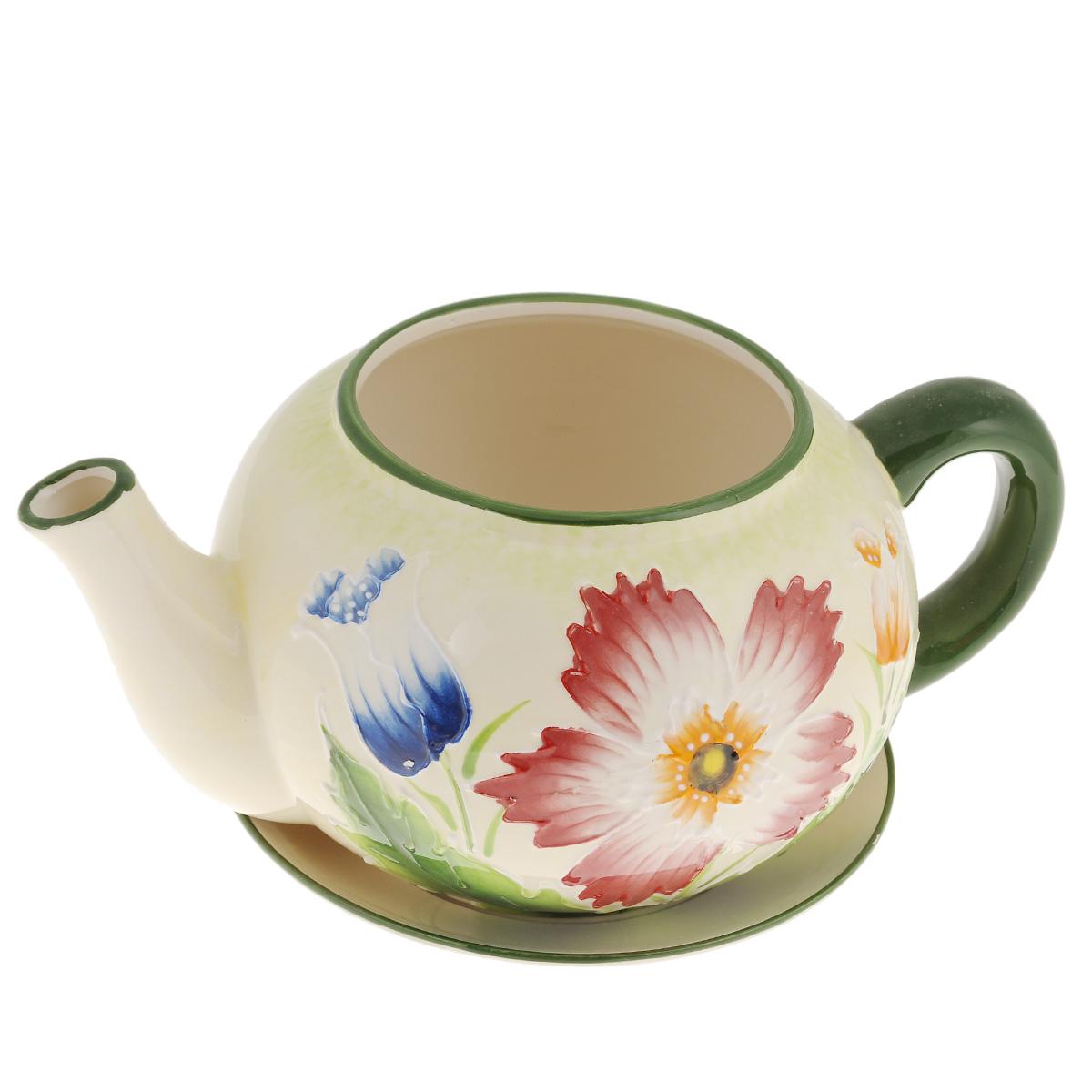 Кашпо Lillo Заварочный чайник, с поддоном. XY10S015-1FXY10S015-1FКашпо-горшок для цветов Lillo Заварочный чайник выполнен из прочной керамики и декорирован красочным рисунком. Изделие предназначено для цветов. Такие изделия часто становятся последним штрихом, который совершенно изменяет интерьер помещения или ландшафтный дизайн сада. Благодаря такому кашпо вы сможете украсить вашу комнату, офис, сад и другие места. Изделие оснащено специальным поддоном - блюдцем. Диаметр кашпо по верхнему краю: 12 см. Высота кашпо (без учета поддона): 14 см. Диаметр поддона: 20,5 см.