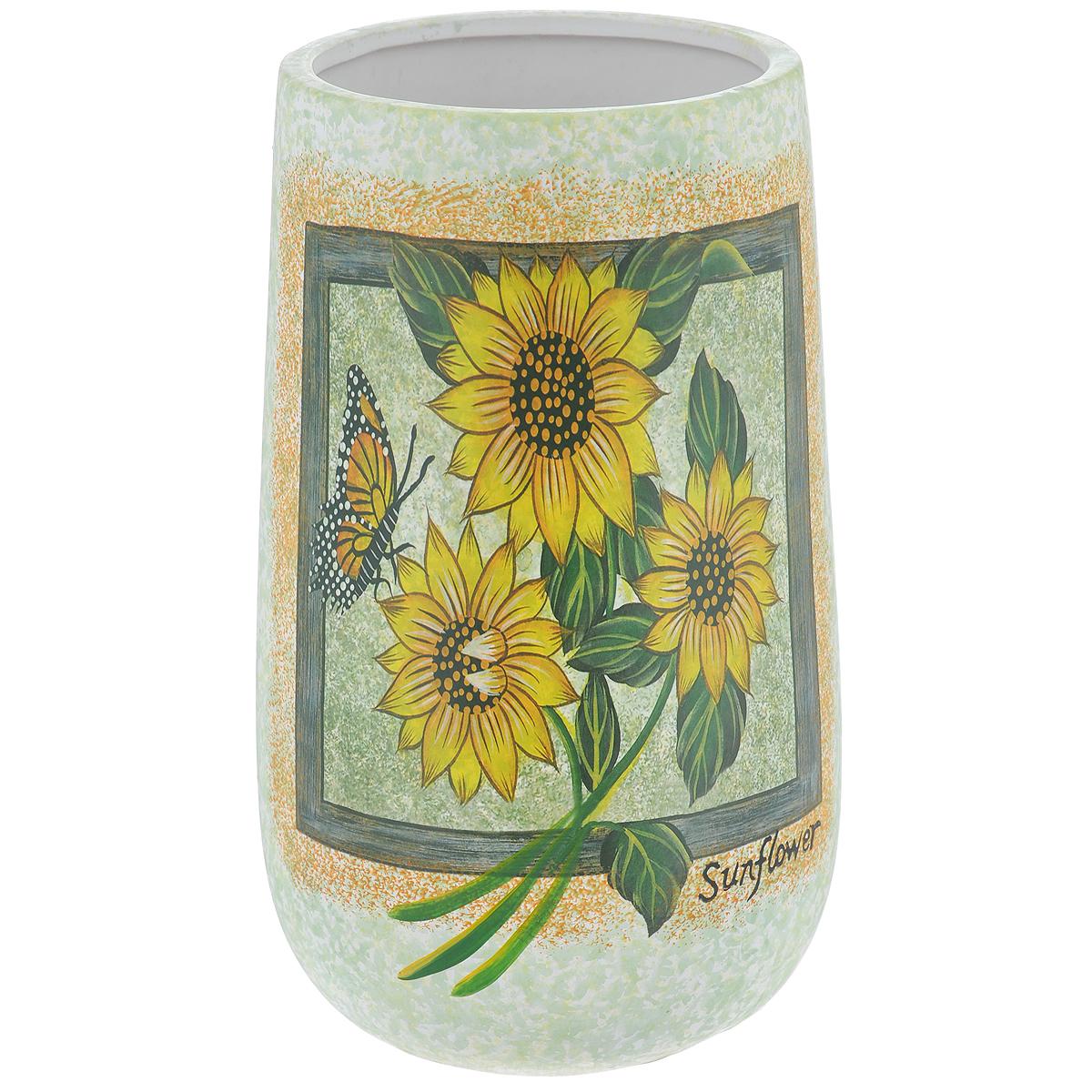Ваза Lillo Солнечные цветы, высота 24,5 смLil 3045Элегантная ваза Lillo Солнечные цветы выполнена из высококачественной керамики и декорирована рисунком. Она придется по вкусу и ценителям классики, и тем, кто предпочитает утонченность и изящность. Вы можете поставить вазу в любом месте, где она будет удачно смотреться и радовать глаз. Такая ваза подойдет и для цветов, и для декора интерьера. Кроме того - это отличный вариант подарка для ваших близких и друзей. Высота вазы: 24,5 см.