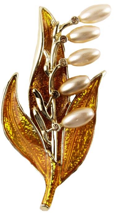 Брошь Ландыши. Бижутерный сплав, австрийские кристаллы, эмаль, искусственный жемчуг. Начало ХХI векаFH32724Брошь Ландыши. Бижутерный сплав, австрийские кристаллы, эмаль, жемчуг. Западная Европа, начало ХХI века. Размер: 7 см х 3,5 см. Сохранность хорошая. Брошь в виде стилизации веточки ландышей. Цветочки выполнены из бусин искусственного жемчуга нежного переливающегося оттенка. Листочки - в технике эмали по металлу. Дополнена брошь австрийскими кристаллами в тон всей броши. Несомненно, эта брошь будет прекрасным дополнением вашей коллекции украшений. Прекрасный выбор как на каждый день, так и на торжественный случай!