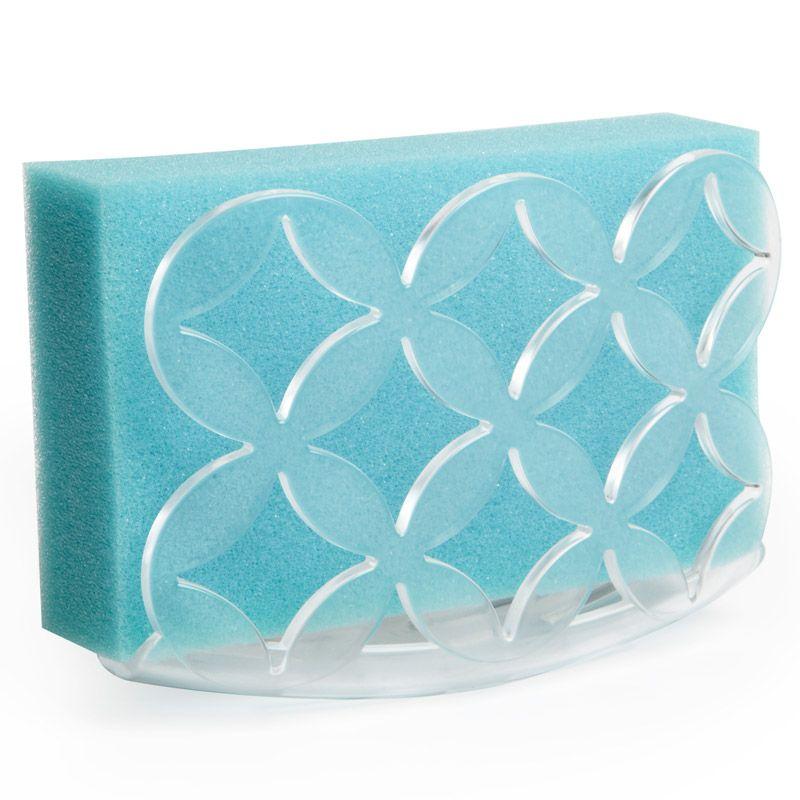 Держатель для губки Umbra Meridian, цвет: прозрачный330886-165Аккуратный и компактный держатель для губок Umbra Meridian выполнен из прочного пластика. Благодаря присоске держатель прочно крепится к таким поверхностям как стекло, нержавеющая сталь, плитка. Способствует скорейшему высыханию губки (таким образом, в губке не будут скапливаться бактерии и не возникнет неприятного запаха). Удобен в использовании, экономит место, легко промывается. Имеет прочный каркас и оригинальный дизайн.
