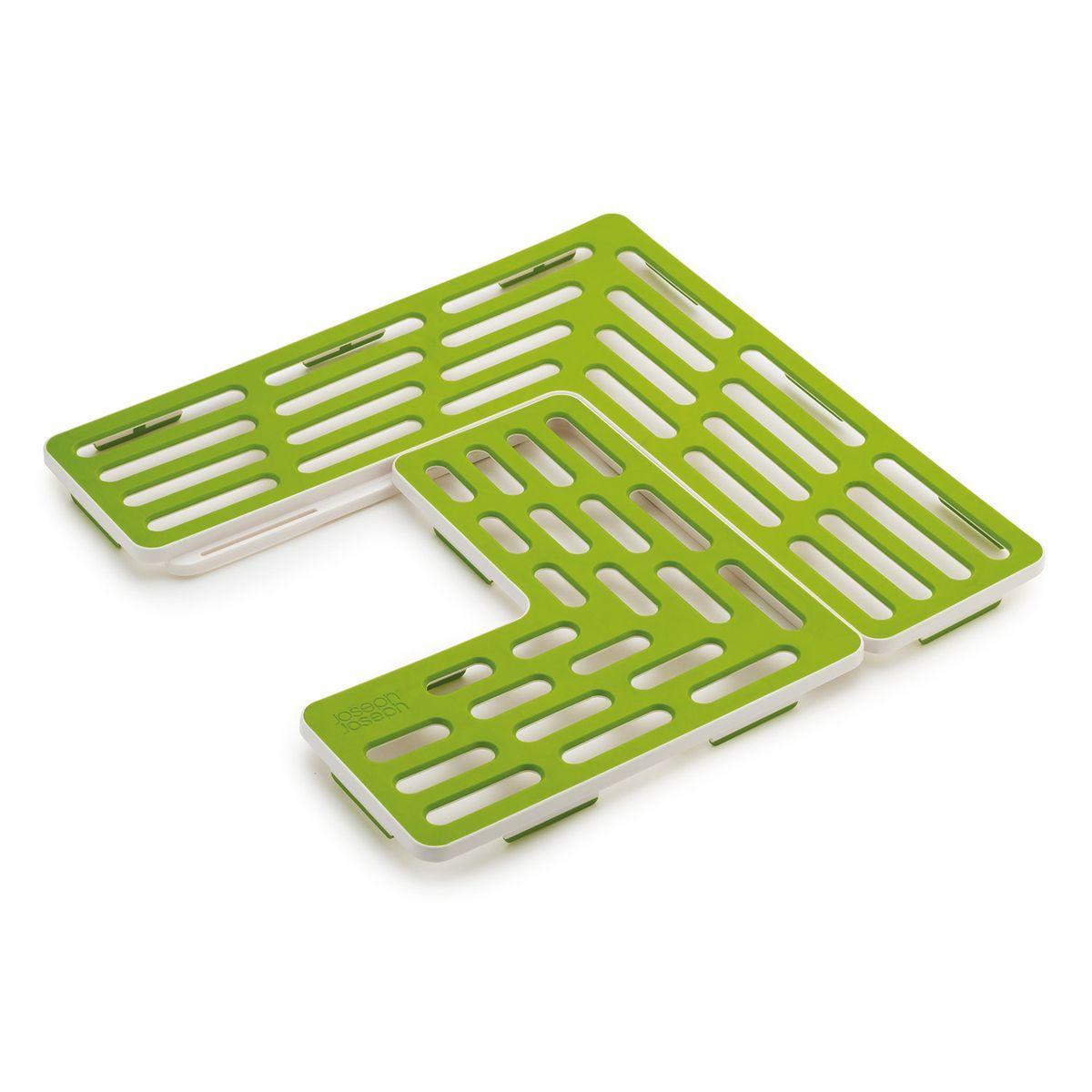 Подложка для раковины Joseph Joseph SinkSaver, цвет: зеленый, белый85036Подложка для раковины Joseph Joseph SinkSaver выполнена из термопластичной резины и пластика. Может показаться, что это конструктор, но на самом деле - это подложка, продуманная до мелочей. Она подходит к раковинам разных форматов и адаптируется под сливное отверстие в центре, слева или справа. Прорезиненная поверхность подложки предотвращает повреждение посуды, сколы и царапинки, даже если вы ее уроните. Так же защищена и сама раковина, она всегда будет выглядеть как новая. Минимальный размер раковины: 31 х 31 см. Максимальный размер подложки: 28 см х 28 см.