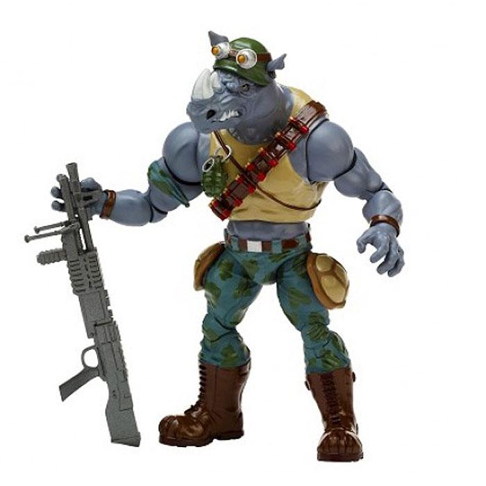 Фигурка Turtles Классическая серия Роктэди, 15 см91086Фигурка Turtles Рокстэди станет прекрасным подарком для вашего ребенка. Она выполнена из прочного пластика в виде Рокстэди. Голова, руки и ноги фигурки подвижны, что позволяет придавать ему различные позы. В комплект входит его оружие: меч и автомат. Ваш ребенок будет часами играть с этой фигуркой, придумывая различные истории с участием знаменитого героя.