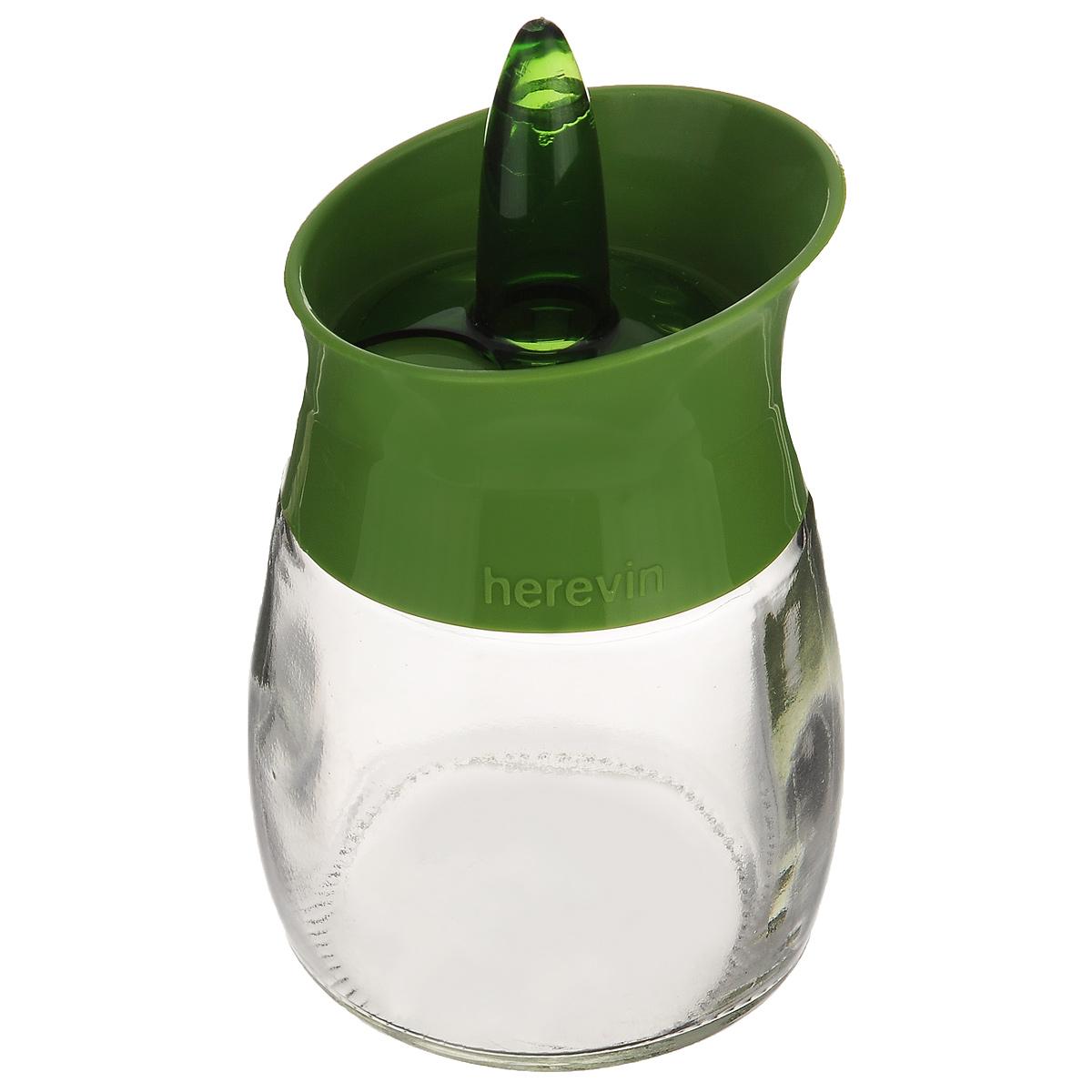 Банка для специй Herevin, цвет: прозрачный, зеленый, 200 мл. 131260-000131260-000_зеленыйБанка для специй Herevin выполнена из прозрачного стекла и оснащена пластиковой цветной крышкой с отверстиями разного размера, благодаря которым, вы сможете приправить блюда, просто перевернув банку. Крышка снабжена поворотным механизмом, благодаря которому вы сможете регулировать степень подачи специй. Крышка легко откручивается, благодаря чему засыпать приправу внутрь очень просто. Такая баночка станет достойным дополнением к вашему кухонному инвентарю. Можно мыть в посудомоечной машине. Диаметр (по верхнему краю): 5,5 см. Высота банки (без учета крышки): 7,5 см.