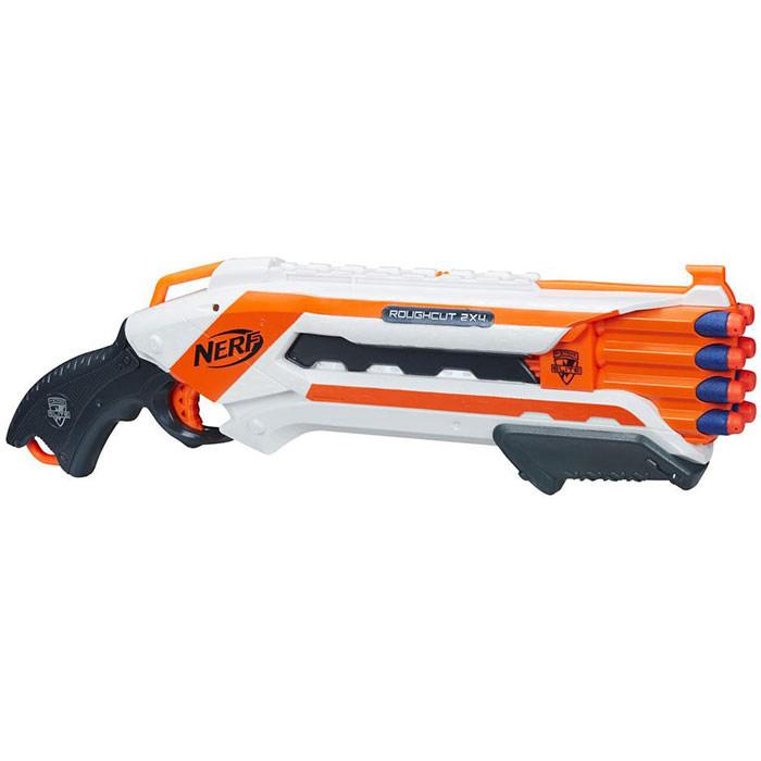 Nerf Бластер Rough Cut 2х4, с патронами, цвет: белый, оранжевыйA1691E35Бластер Nerf Rough Cut 2х4 позволит вашему ребенку почувствовать себя во всеоружии. Бластер выполнен из яркого безопасного пластика и снабжен восьмизарядной обоймой. Может стрелять по два патрона за выстрел. Комплект включает в себя восемь патронов, выполненных из гибкого вспененного полимера. Бластер стреляет на расстояние до 20 метров. Игра с таким бластером поможет ребенку в развитии меткости, ловкости, координации движений и сноровки.