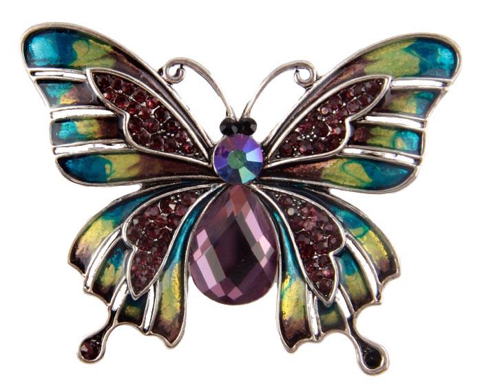 Брошь Карнавальная бабочка. Металл, полихромные эмали, австрийские кристаллы. Конец XX векаАРТ, BR0002Брошь Карнавальная бабочка. Металл, композитный материал , австрийские кристаллы. Западная Европа, конец XX века. Размеры 5 х 4 см. Сохранность хорошая. Очаровательная брошь, выполненная в виде бабочки. Аксессуар инкрустирован стразами разных форм и размеров . Особую оригинальность этому изделию придает сложное сочетание цветной эмали. Эта неповторимая брошь станет стильным украшением для романтичной и творческой натуры и гармонично дополнит Ваш наряд, станет завершающим штрихом в создании образа.