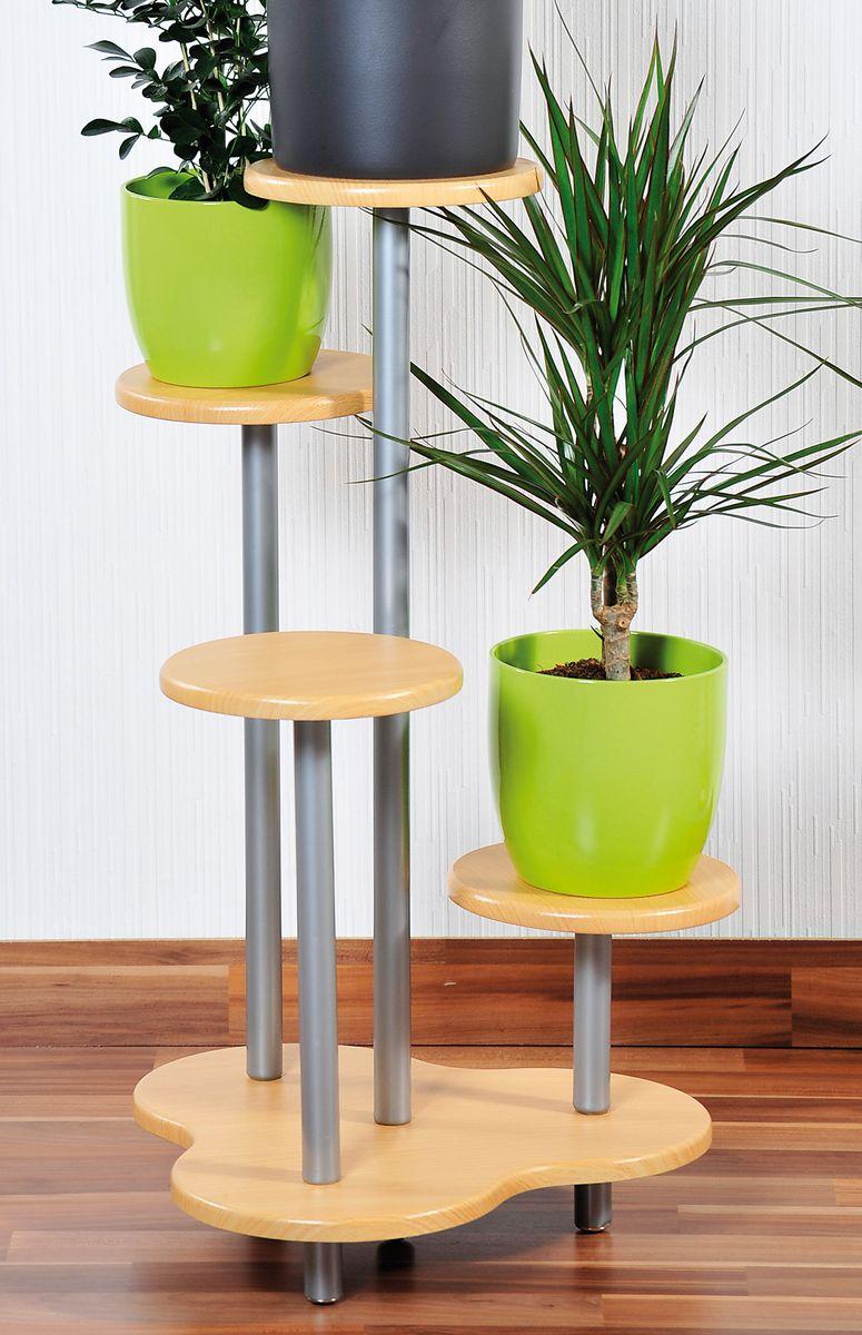 Подставка под цветочные горшки Kesper, высота 75 см1728-0Стильная подставка Kesper поможет компактно расставить горшки с цветами. Подставка, выполненная из металла и дерева, рассчитана на четыре горшка. Такая подставка поможет любителям цветов сэкономить пространство, при этом вид цветущих растений всегда будет вас радовать. Диаметр подставки под горшок: 20 см. Высота полки: 75 см.
