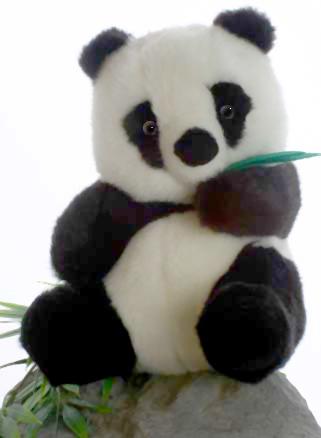 Мягкая игрушка Hansa Панда, 25 см1723Оригинальная мягкая игрушка Панда принесет радость и подарит своему обладателю мгновения нежных объятий и приятных воспоминаний. Игрушка очень похожа на своего живого прототипа, она станет замечательным другом и наполнит игру эмоциями и яркими впечатлениями. Игрушки фирмы Hansa шьются и набиваются вручную, что позволяет достигнуть максимальной реалистичности образа. Данная игрушка выполнена из искусственного меха, специально обработанного для придания схожести с мехом конкретного вида животного. В лапах панда держит листья бамбука, что делает ее очаровательной. Глаза выполнены из пластика. Игрушка удивительно мягкая и приятная на ощупь. Великолепное качество исполнения делают эту игрушку чудесным подарком к любому празднику, как для ребенка, так и для взрослого.