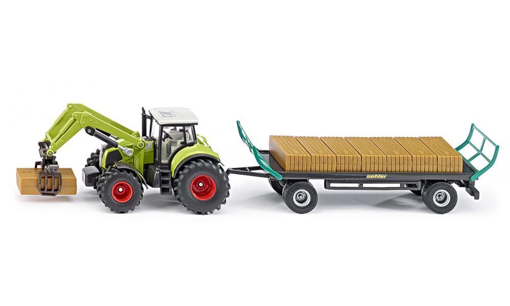 Siku Трактор Claas с прицепом Oehler1946Трактор Siku Claas с прицепом Oehler выполнен в масштабе 1:50. В набор входят модель трактора и модель прицепа для перевозки грузов. Манипулятор способен захватывать груз. Прицеп оборудован сцепным устройством. В набор также входят имитация грузов, изготовленных из безопасного пластика. Игры с моделями способствуют развитию воображения, мышления, мелкой моторики рук и координации движений.
