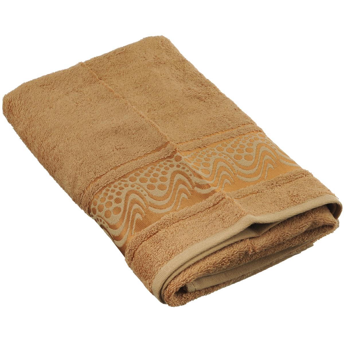 Полотенце Mariposa Aqua, цвет: светло-коричневый, 50 х 90 см62407Полотенце Mariposa Aqua, изготовленное из 60% бамбука и 40% хлопка, подарит массу положительных эмоций и приятных ощущений. Полотенца из бамбука только издали похожи на обычные. На самом деле, при первом же прикосновении вы ощутите невероятную мягкость и шелковистость. Таким полотенцем не нужно вытираться - только коснитесь кожи - и ткань сама все впитает! Несмотря на богатую плотность и высокую петлю полотенца, оно быстро сохнет, остается легким даже при намокании. Полотенце оформлено волнистым рисунком. Благородный тон создает уют и подчеркивает лучшие качества махровой ткани. Полотенце Mariposa Aqua станет достойным выбором для вас и приятным подарком для ваших близких. Размер полотенца: 50 см х 90 см.