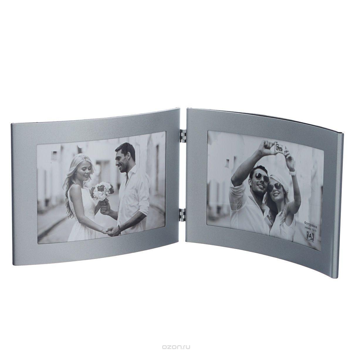 Фоторамка Image Art 6015/2-4S ( серебро)5055398693070Фоторамка Image Art - прекрасный способ красиво оформить ваши фотографии. Изделие рассчитано на 2 фотографии. Фоторамка выполнена из металла и защищена стеклом. Фоторамку можно поставить на стол или подвесить на стену, для чего с задней стороны предусмотрены специальные отверстия. Такая фоторамка поможет сохранить на память самые яркие моменты вашей жизни, а стильный дизайн сделает ее прекрасным дополнением интерьера.