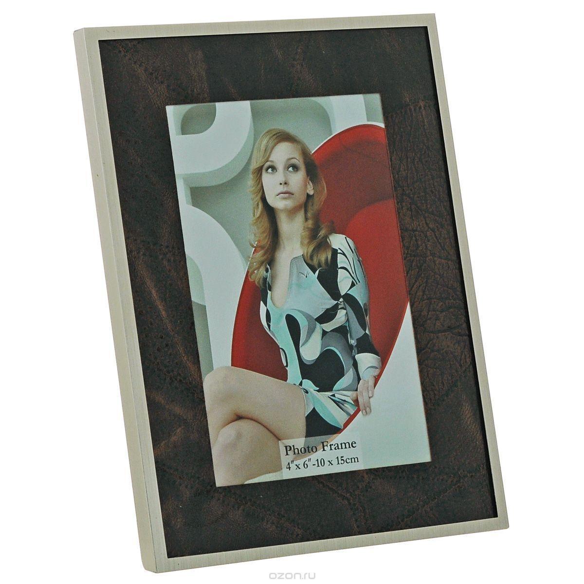 Фоторамка Image Art 6035-4G6035-4GФоторамка Image Art - прекрасный способ красиво оформить ваши фотографии. Изделие рассчитано на 2 фотографии. Фоторамка выполнена из металла и защищена стеклом. Фоторамку можно поставить на стол или подвесить на стену, для чего с задней стороны предусмотрены специальные отверстия. Такая фоторамка поможет сохранить на память самые яркие моменты вашей жизни, а стильный дизайн сделает ее прекрасным дополнением интерьера.