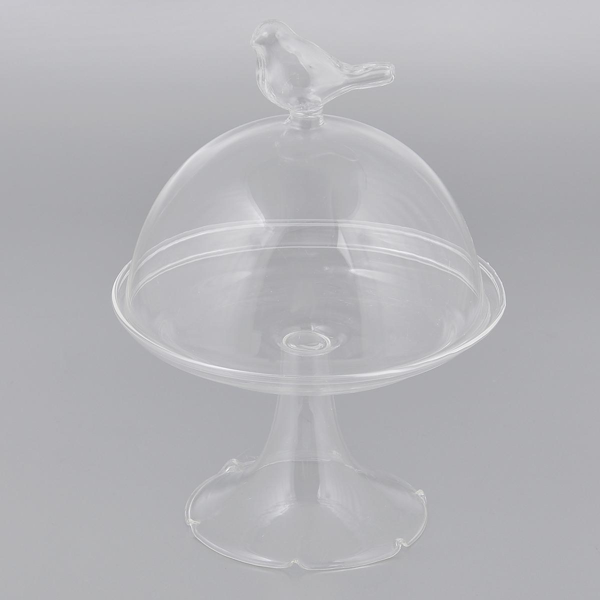 Пирожница c куполом Dolce Arti Птичка, диаметр 15,5 смDA010107Пирожница c куполом Dolce Arti изготовлена из прозрачного стекла. Изделие представляет собой изящную тарелочку на ножке и крышку-купол, украшенную фигуркой птички. Такая пирожница может использоваться как столовая посуда для хранения пирожных, конфет и сладостей, а также прекрасно подойдет как декоративный элемент. Изделие по своему усмотрению можно задекорировать в техниках декупаж или роспись. Также подходит для различных творческих изделий во флористических и других композициях. Диаметр тарелочки: 15,5 см. Высота пирожницы (с куполом): 21 см.