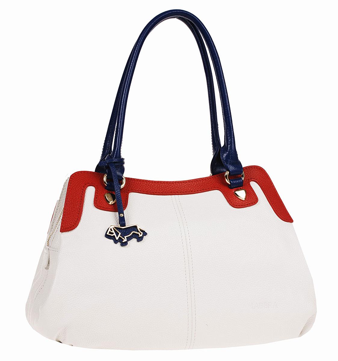 Сумка женская Labbra, цвет: белый, синий, красный. L-DL90456L-DL90456Лаконичная женская сумка Labbra выполнена из натуральной кожи контрастных оттенков и дополнена оригинальной металлической подвеской с логотипом бренда. Изделие содержит одно основное отделение, закрывающееся на молнию. Внутри - врезной карман на молнии и два накладных кармашка для мобильного телефона и различных мелочей. Сумка оснащена двумя удобными ручками, которые дополнены оригинальными металлическими элементами. Дно сумки оснащено металлическими ножками, которые дополнительно защитят изделие от повреждений. Стильная сумка позволит вам подчеркнуть свою индивидуальность, и сделает ваш образ изысканным и завершенным.