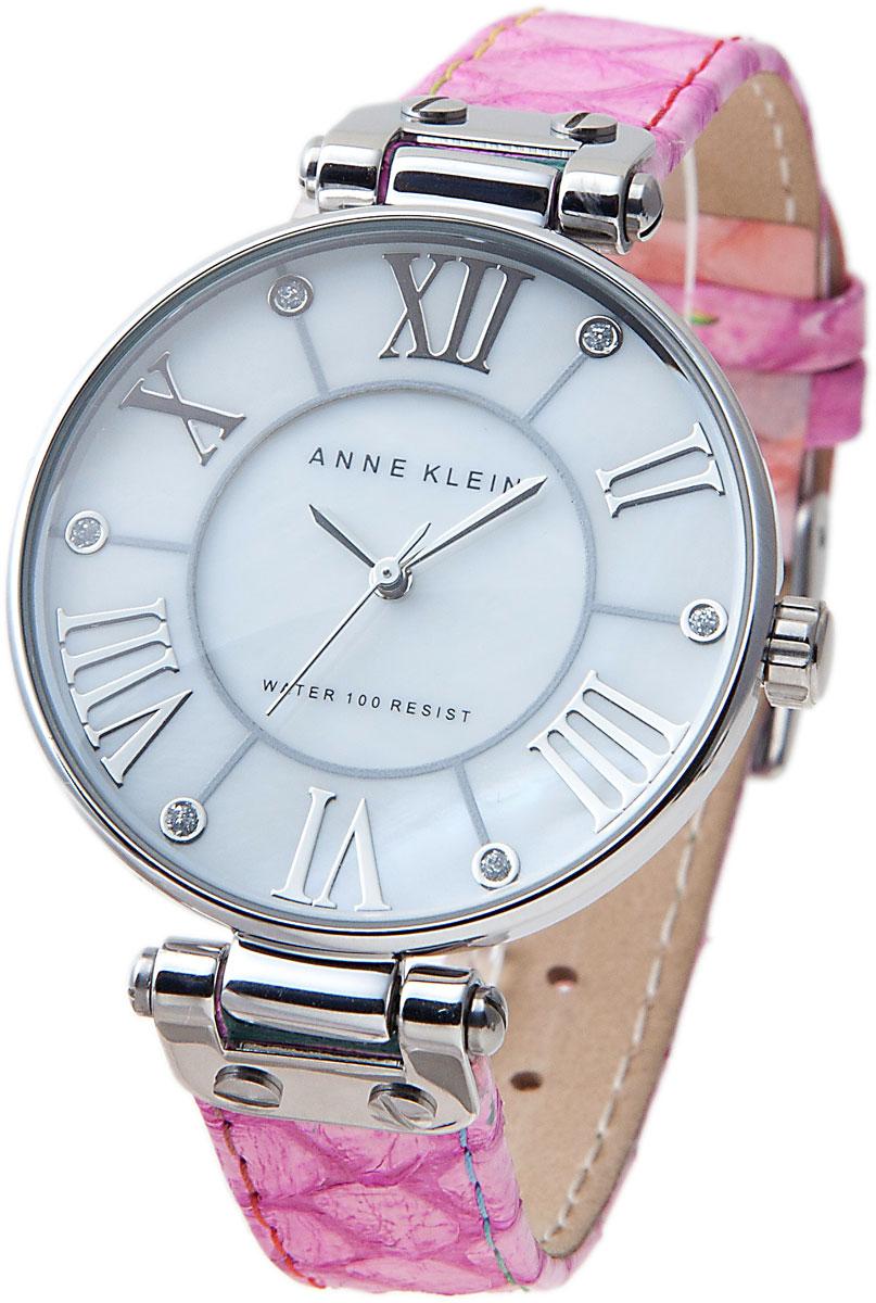 Часы наручные женские Anne Klein RING, цвет: розовый, стальной. 1335MPPK1335MPPKЭлегантные женские часы Anne Klein RING выполнены из нержавеющей стали с PVD-покрытием, натуральной кожи и минерального стекла. Циферблат изделия дополнен символикой бренда. Часы оснащены кварцевым механизмом с тремя стрелками, полированным корпусом, устойчивым к царапинам минеральным стеклом, степенью влагозащиты 3atm. Изделие дополнено кожаным ремешком, позволяющим максимально комфортно и быстро снимать и одевать часы при помощи пряжки. Часы поставляются в фирменной упаковке. Стильные часы Anne Klein RING подчеркнут изящество женской руки и отменное чувство стиля их обладательницы.