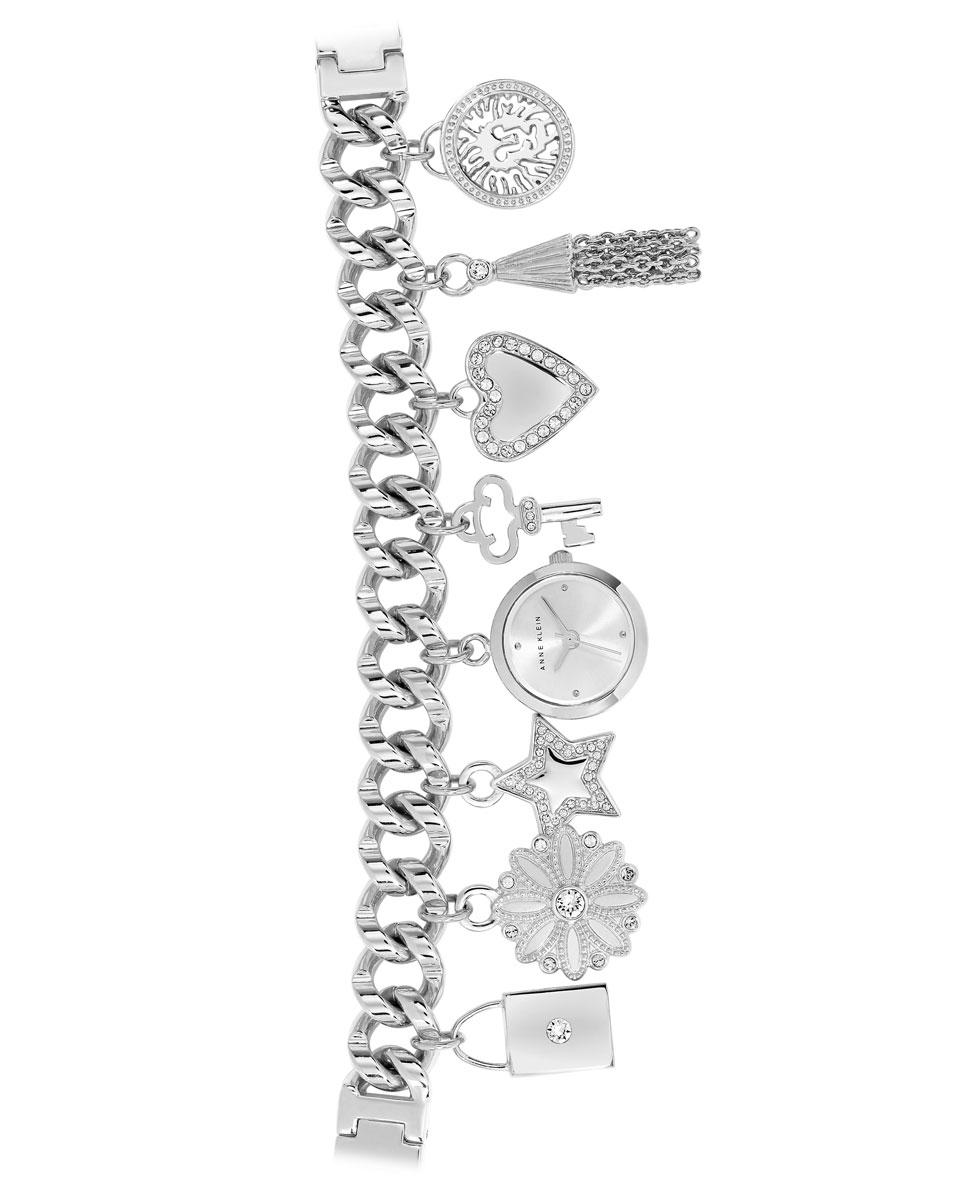 Часы наручные женские Anne Klein TIME TO CHARME, цвет: стальной. 1817CHRM1817CHRMЭлегантные женские часы Anne Klein TIME TO CHARME выполнены из нержавеющей стали с PVD покрытием, минерального стекла, чешских кристаллов. Часы оформлены в виде браслета с восьмью оригинальными подвесками, среди которых представлен корпус самих часов. Циферблат изделия дополнен символикой бренда. Подвески выполнены в виде: замочка; цветка; звезды; ключика; сердца; кисточки; медальона с изображением льва. Часы оснащены кварцевым механизмом с тремя стрелками, полированным корпусом, устойчивым к царапинам минеральным стеклом, степенью влагозащиты 3atm. Объемный ажурный браслет оснащен практичным замком-пряжкой. Часы поставляются в фирменной упаковке. Стильные часы Anne Klein TIME TO CHARME подчеркнут изящество женской руки и отменное чувство стиля их обладательницы.
