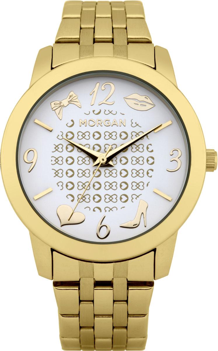 Набор MORGAN: наручные часы, зеркало, цвет: золотой, белый. M1140GMM1140GMНабор MORGAN включающий в себя наручные часы и зеркало. Элегантные наручные часы MORGAN выполнены из нержавеющей стали с IP-покрытием цвета желтого золота, минерального стекла. Циферблат изделия оформлен символикой бренда и дополнен кокетливыми изображениями бантика, губ, сердца и туфельки. Часы оснащены механизмом Miyota с тремя стрелками, полированным корпусом, устойчивым к царапинам минеральным стеклом, степенью водозащиты 3atm. Изделие дополнено стальным браслетом, который закрывается на застежку-клипсу. Компактное зеркало раскрывается при помощи механизма на защелке, изделие оформлено сердечком из страз. Набор MORGAN поставляется в фирменной упаковке. Стильные часы подчеркнут изящество женской руки и отменное чувство стиля их обладательницы.