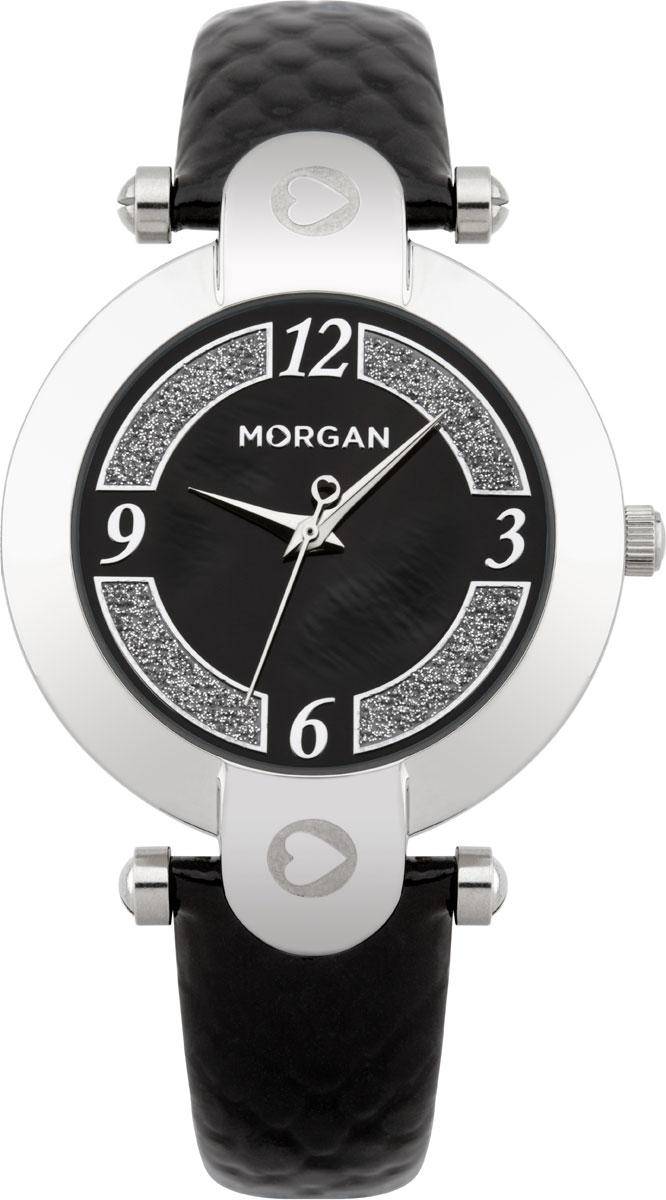 Наручные часы женские Morgan, цвет: черный, серебристый. M1134BBRM1134BBRЭлегантные наручные часы Morgan выполнены из нержавеющей стали с IP-покрытием серебристого цвета, минерального стекла. Циферблат изделия дополнен символикой бренда и блестками. Часы оснащены механизмом Miyota с тремя стрелками, полированным корпусом, устойчивым к царапинам минеральным стеклом, степенью влагозащиты 3atm. Изделие дополнено ремешком из натуральной кожи с тиснением под рептилию. Ремень оснащен застежкой-пряжкой с возможностью регулировать длину изделия. Часы поставляются в фирменной упаковке. Стильные часы подчеркнут изящество женской руки и отменное чувство стиля их обладательницы.