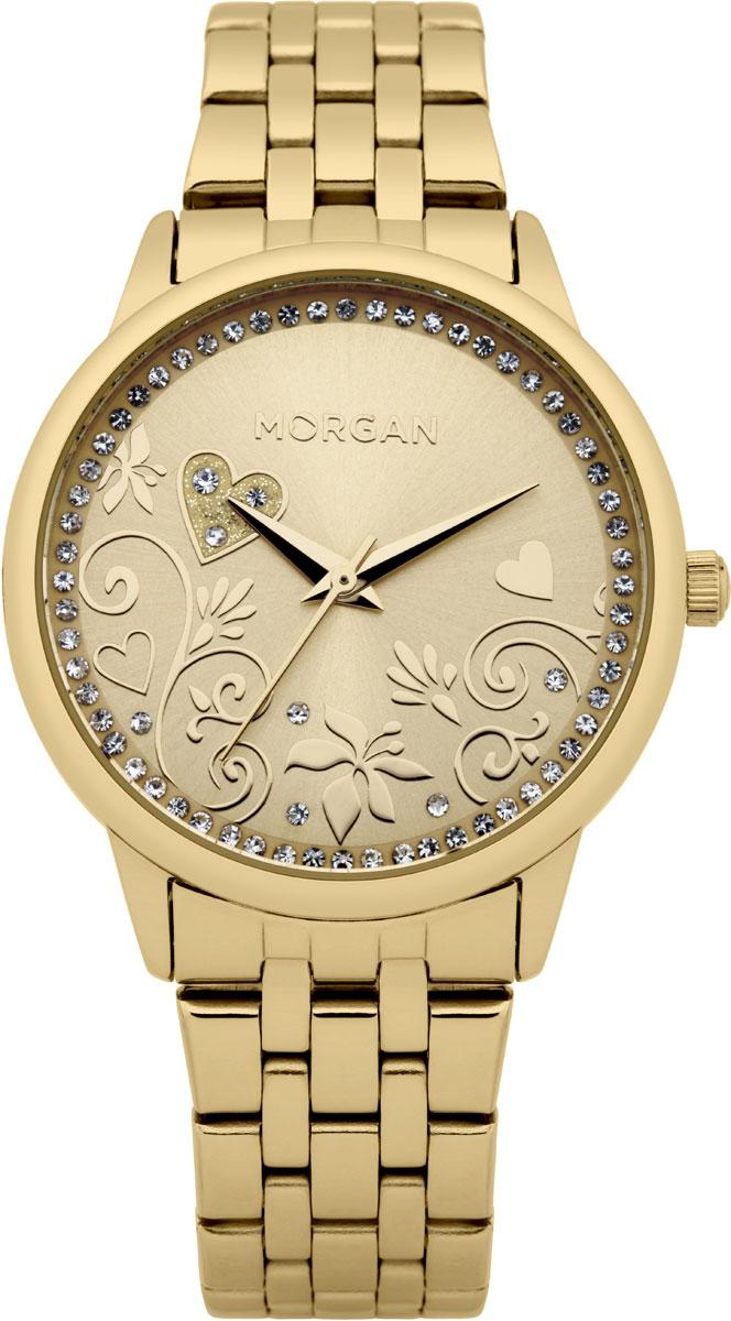 Набор MORGAN: наручные часы, зеркало, цвет: золотой. M1130GMBRM1130GMBRНабор MORGAN включающий в себя наручные часы и зеркало. Элегантные наручные часы MORGAN выполнены из нержавеющей стали с IP-покрытием цвета желтого золота, минерального стекла и дополнены чешскими кристаллами. Циферблат изделия оформлен цветочным узором, который изящно дополняют кристаллы. Часы оснащены механизмом Miyota с тремя стрелками, устойчивым к царапинам минеральным стеклом, степенью водозащиты 3atm. Изделие дополнено стальным браслетом, который закрывается на застежку-клипсу. Компактное зеркало раскрывается при помощи механизма на защелке, изделие оформлено сердечком из страз. Набор MORGAN поставляется в фирменной упаковке. Стильные часы подчеркнут изящество женской руки и отменное чувство стиля их обладательницы.