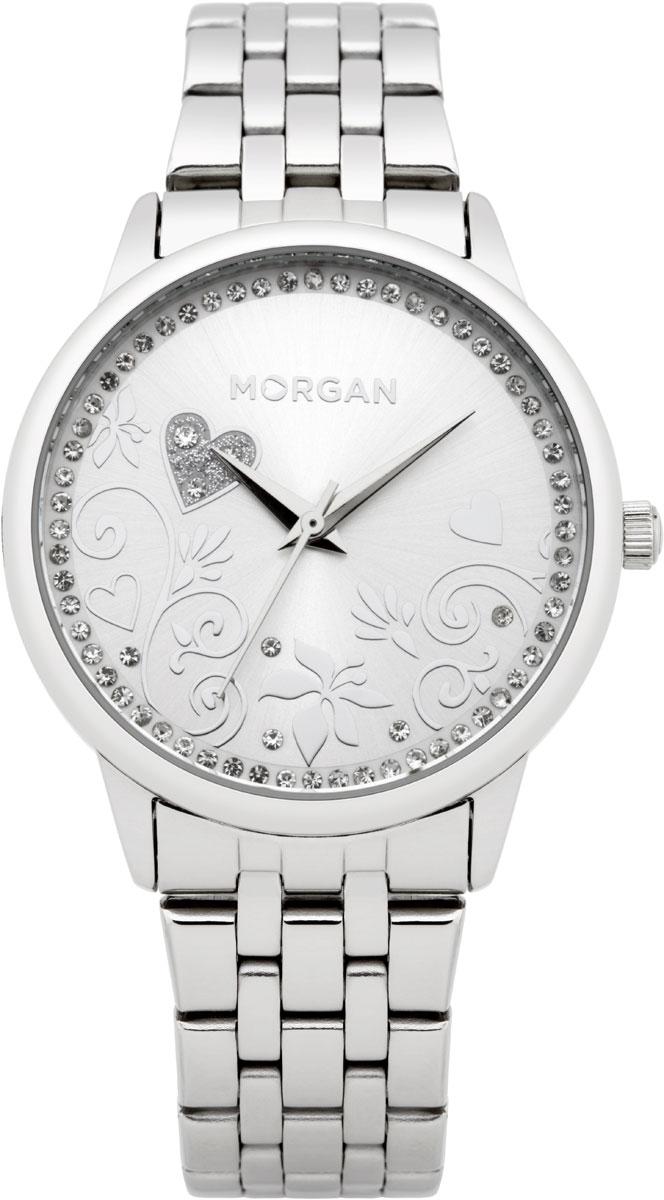 Набор MORGAN: наручные часы, зеркало, цвет: серебристый. M1130SMBRM1130SMBRНабор MORGAN включающий в себя наручные часы и зеркало. Элегантные наручные часы MORGAN выполнены из нержавеющей стали, минерального стекла и дополнены чешскими кристаллами. Циферблат изделия оформлен цветочным узором, который изящно дополняют кристаллы. Часы оснащены механизмом Miyota с тремя стрелками, устойчивым к царапинам минеральным стеклом, степенью водозащиты 3atm. Изделие дополнено стальным браслетом, который закрывается на застежку-клипсу. Компактное зеркало раскрывается при помощи механизма на защелке, изделие оформлено сердечком из страз. Набор MORGAN поставляется в фирменной упаковке. Стильные часы подчеркнут изящество женской руки и отменное чувство стиля их обладательницы.