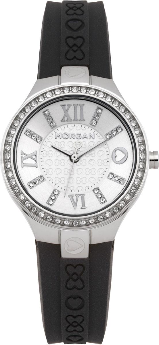 Наручные часы женские Morgan, цвет: черный, серебристый. M1138SBRM1138SBRЭлегантные наручные часы Morgan выполнены из нержавеющей стали с IP-покрытием серебристого цвета, минерального стекла. Циферблат изделия дополнен символикой бренда и чешскими кристаллами. Часы оснащены механизмом Miyota с тремя стрелками, полированным корпусом, устойчивым к царапинам минеральным стеклом, степенью влагозащиты 3atm. Изделие дополнено силиконовым ремешком с символикой бренда. Ремень оснащен застежкой-пряжкой с возможностью регулировать длину изделия. Часы поставляются в фирменной упаковке. Стильные часы подчеркнут изящество женской руки и отменное чувство стиля их обладательницы.
