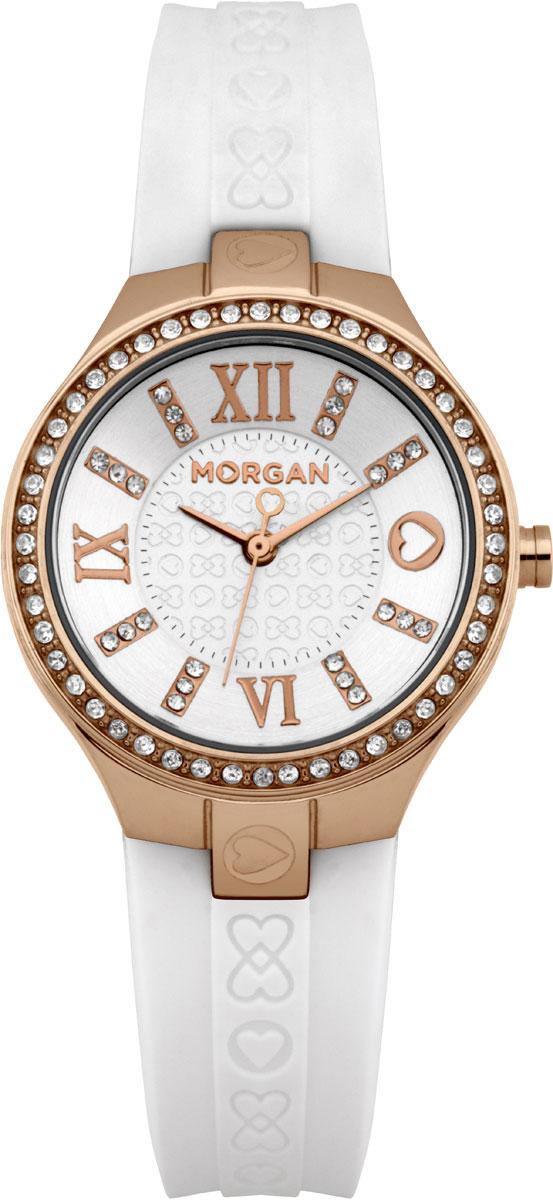 Наручные часы женские Morgan, цвет: белый, золотистый. M1138WGBRM1138WGBRЭлегантные наручные часы Morgan выполнены из нержавеющей стали с IP-покрытием серебристого цвета, минерального стекла. Циферблат изделия дополнен символикой бренда и чешскими кристаллами. Часы оснащены механизмом Miyota с тремя стрелками, полированным корпусом, устойчивым к царапинам минеральным стеклом, степенью влагозащиты 3atm. Изделие дополнено силиконовым ремешком с символикой бренда. Ремень оснащен застежкой-пряжкой с возможностью регулировать длину изделия. Часы поставляются в фирменной упаковке. Стильные часы подчеркнут изящество женской руки и отменное чувство стиля их обладательницы.