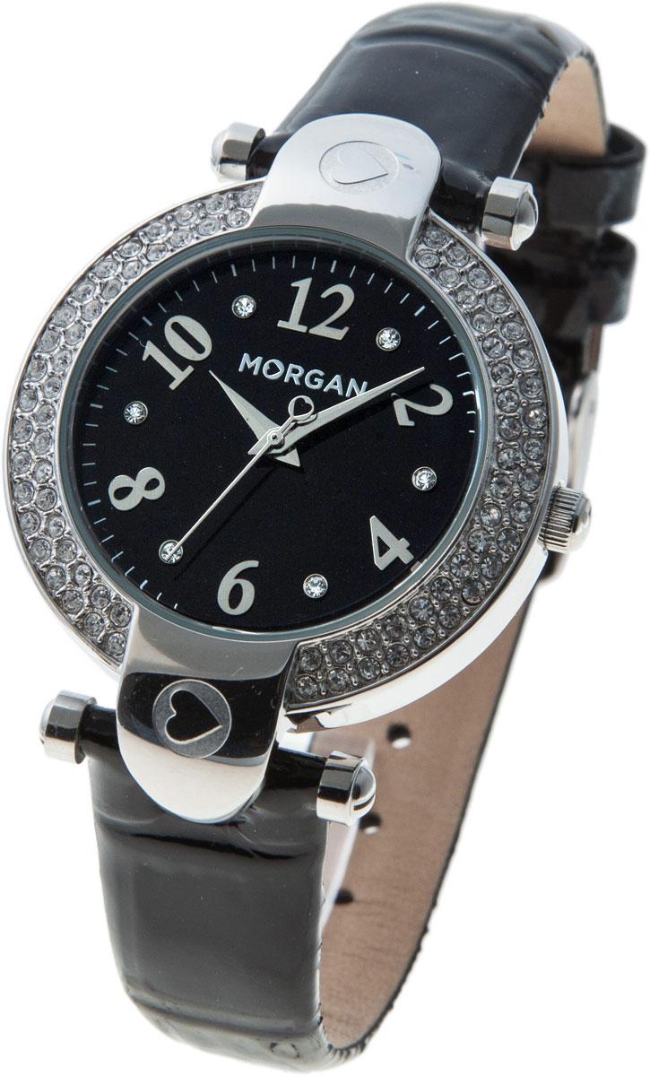 Наручные часы женские Morgan, цвет: черный, серебристый. M1156BM1156BЭлегантные наручные часы Morgan выполнены из нержавеющей стали с IP-покрытием золотистого цвета, минерального стекла, натуральной лакированной кожи. Циферблат изделия оформлен символикой бренда и дополнен чешскими кристаллами. Часы оснащены механизмом Miyota с тремя стрелками, полированным корпусом, устойчивым к царапинам минеральным стеклом, степенью водозащиты 3atm. Изделие дополнено ремешком из натуральной кожи. Ремень оснащен застежкой-пряжкой с возможностью регулировать длину изделия. Часы поставляются в фирменной упаковке. Стильные часы подчеркнут изящество женской руки и отменное чувство стиля их обладательницы.
